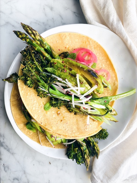 Charred Avocado, Baby Broccoli and Asparagus Tacos - the perfect spring taco that's refreshing, vegan and plantbased, filling, and DELICIOUS! Vegan Tacos for the win! Foody First #vegan #plantbased #glutenfree #tacos #tacotuesday #springfood #avocado #vegantacos