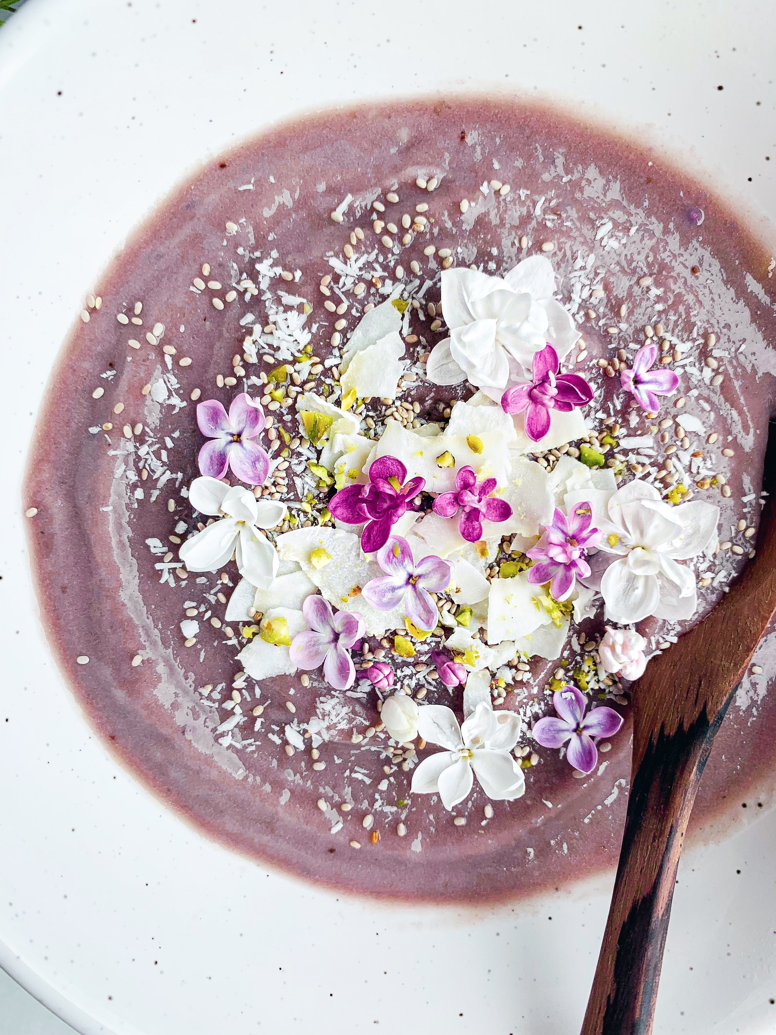 Lilac Nice Cream with Edible Flowers {Vegan, Gluten Free, Paleo} - A 3-ingredient plantbased, vegan, ice cream or smoothie bowl that has 2 simple ingredients, frozen bananas and steamed then frozen purple cauliflower. Perfect for a summer day! Just so happens to be gluten free and paleo as well - Foody First - #vegan #plantbased #nicecream #lilacs #edibleflowers #glutenfree #paleo #smoothiebowl