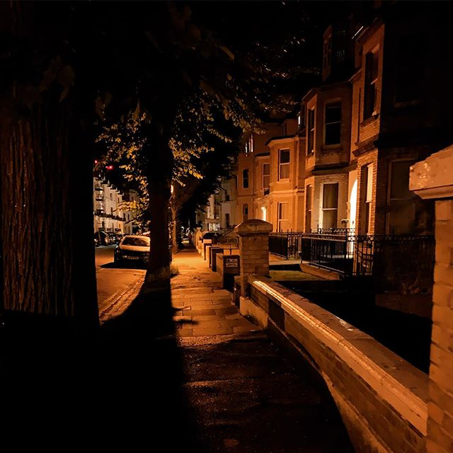 Walking past the Victorian townhouses felt ethereal. I had just got back from watching the partial lunar eclipse though. Makes such a difference having the tree line diffusing the street light. We need to introduce more greenery in urban areas.  #victoriantownhouse #ethereallight #streetscene #streetlight #brightonarchitecture #nightwalk #brightonarchitect #streettrees #urbantrees #victorianarchitecture #naturalvignette