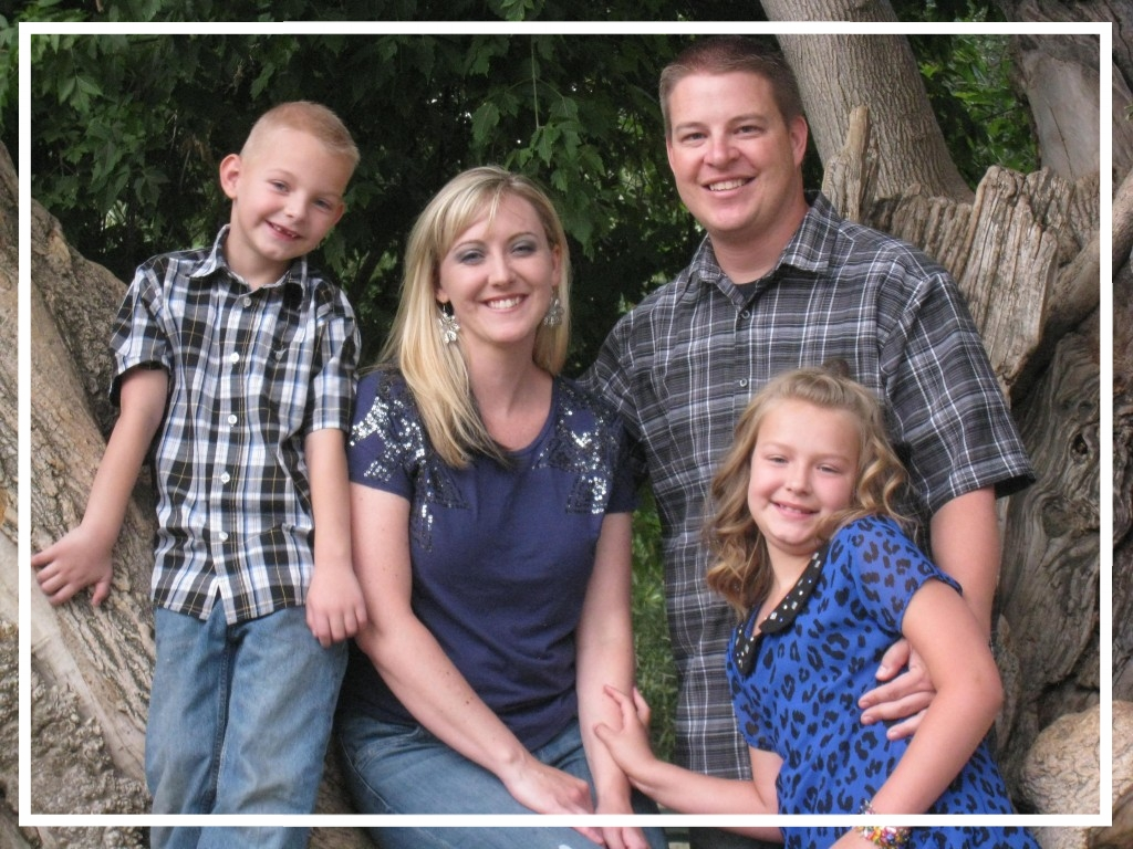 Officer Shaun Cowley and his wife and two children