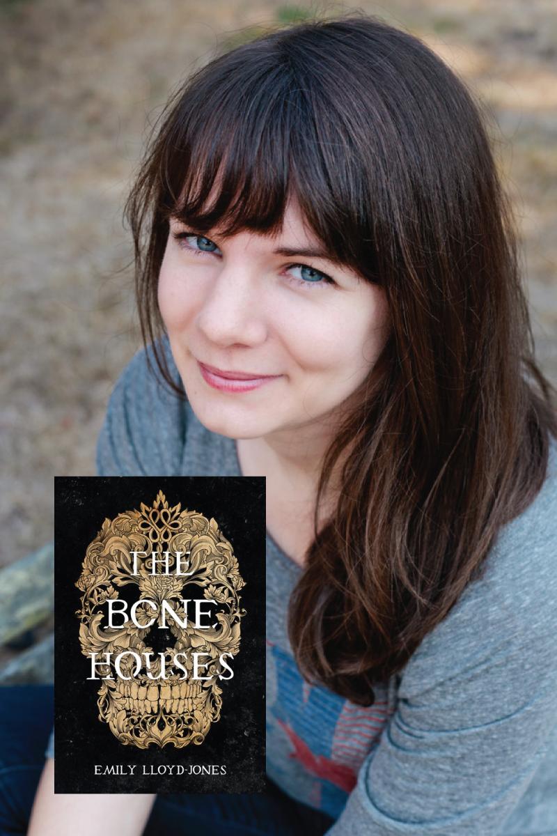 Emily Lloyd-Jones with her book The Bone Houses