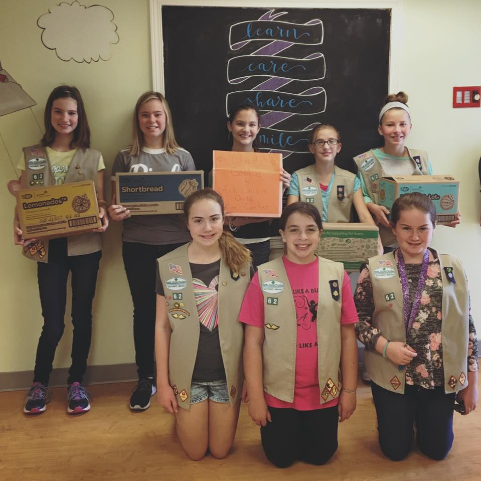 Girl Scout Troop 62 celebrated International Day of the Girl by donating cookies and playing with Ark's children. The scouts also organized Ark's library.
