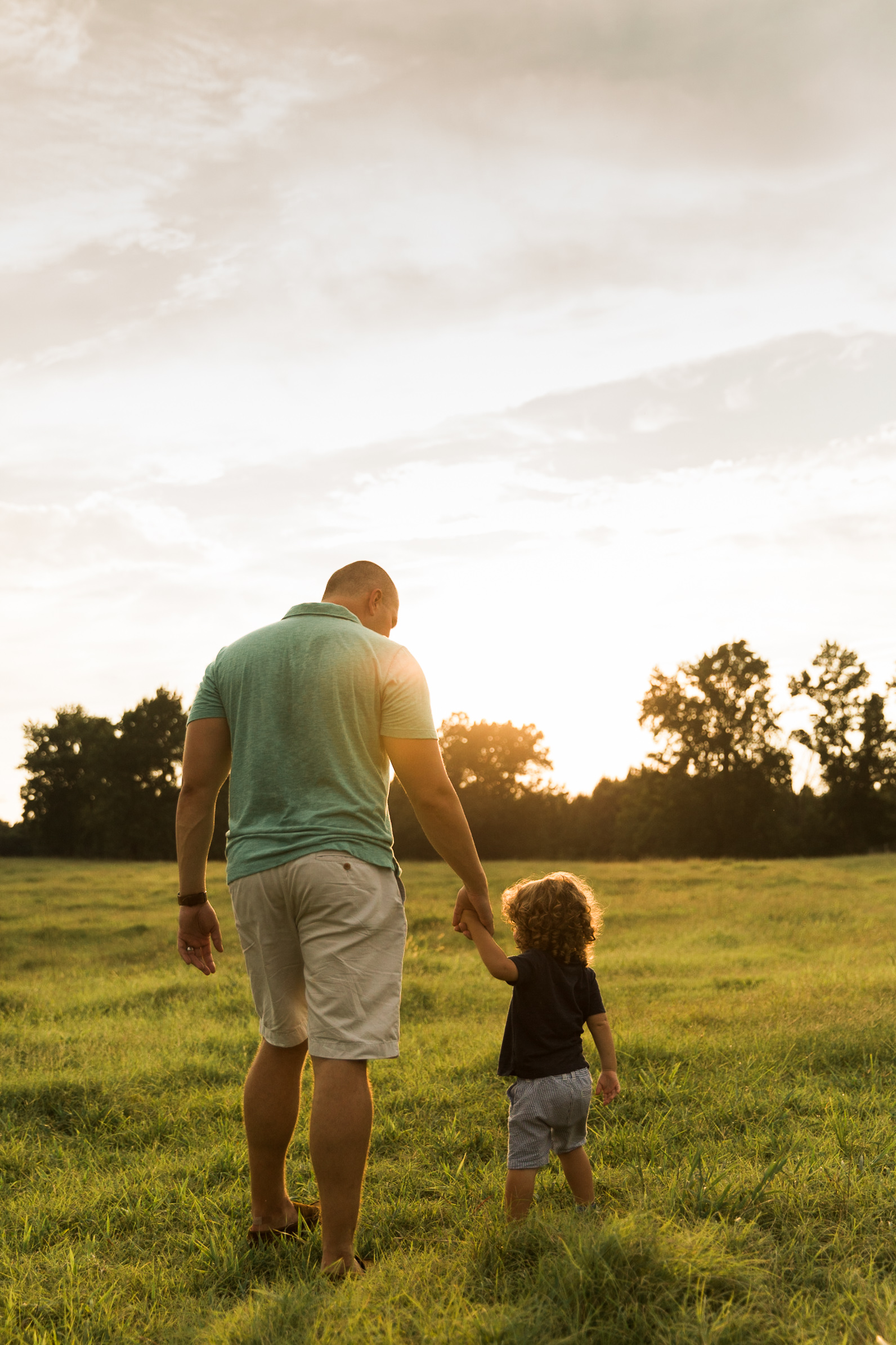 cute boy and father in evening sun