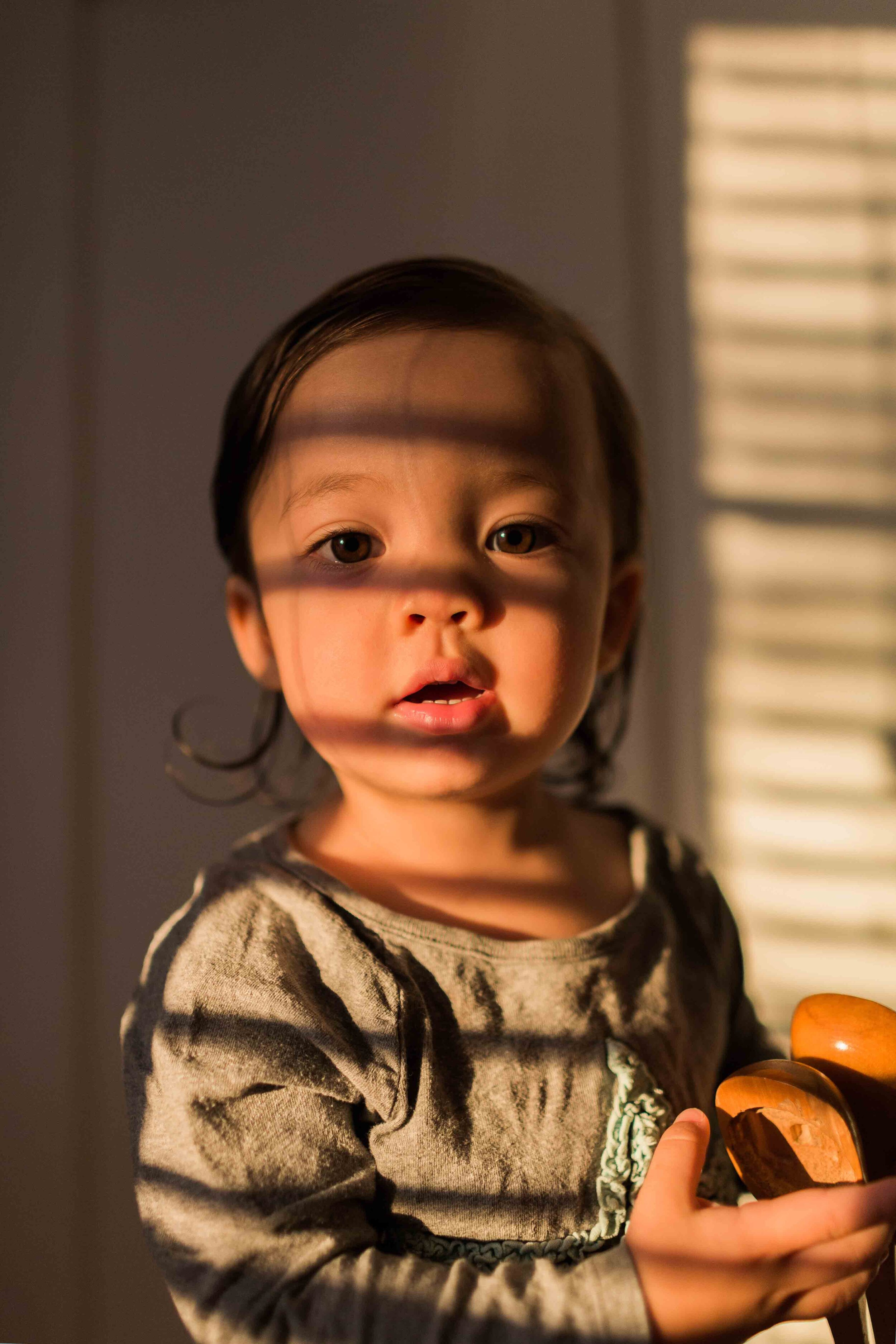 light through window blinds onto baby's face