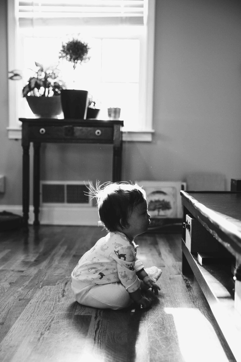 silhouette of baby playing