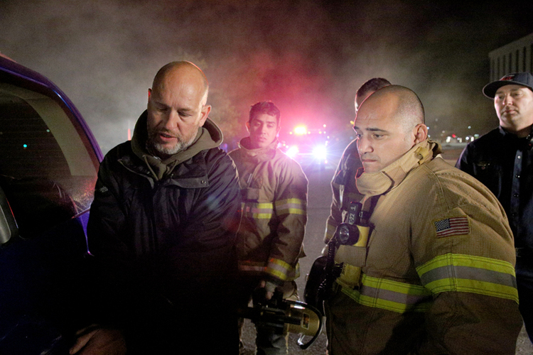 Sean Broughton (left) directs members of the Albuquerque Fire Department before a pivotal rescue scene in the BKLUP TV spot.