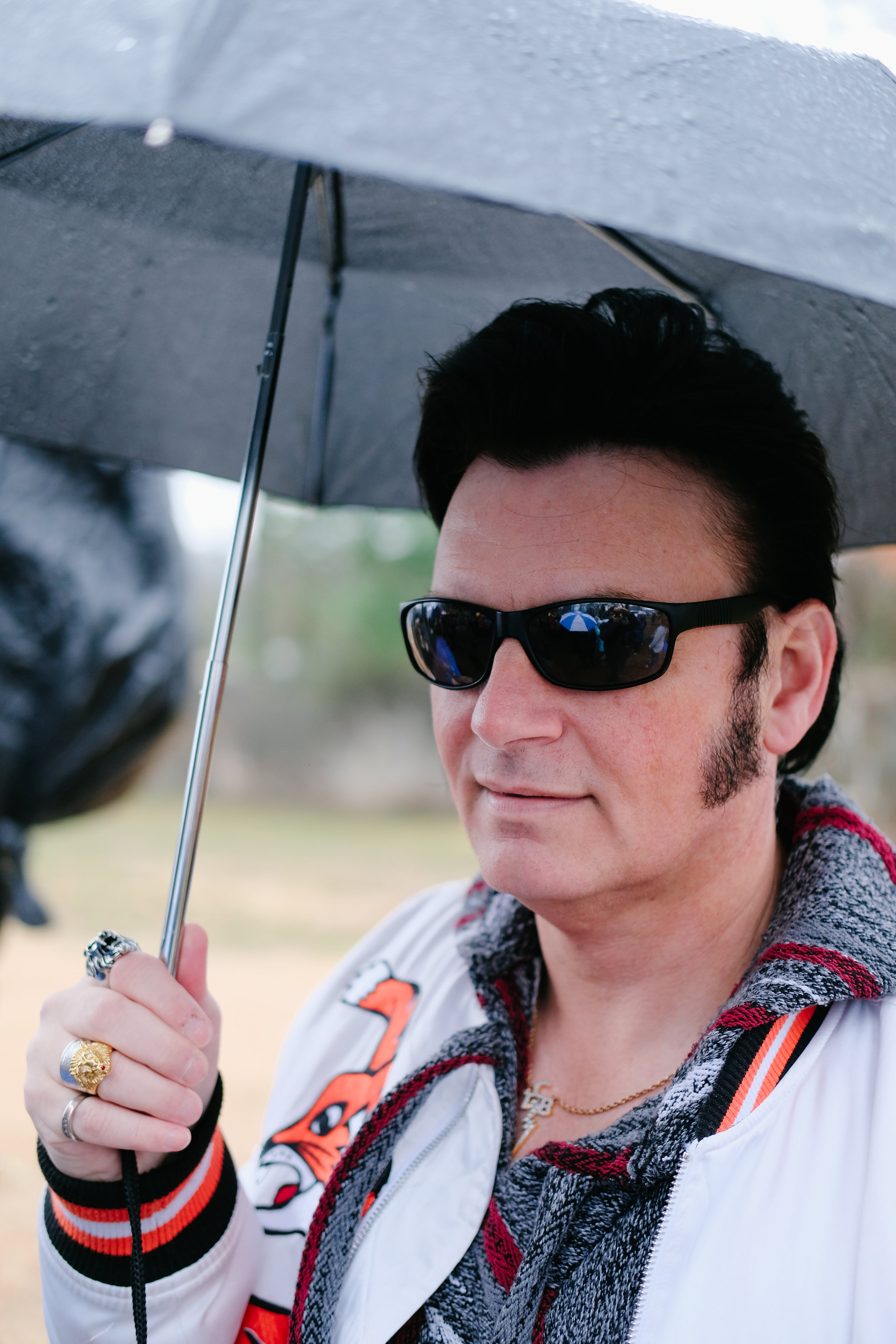 An Elvis fan comes in costume to celebrate the King's birthday, undeterred by the rainy weather, January 8, 2018.