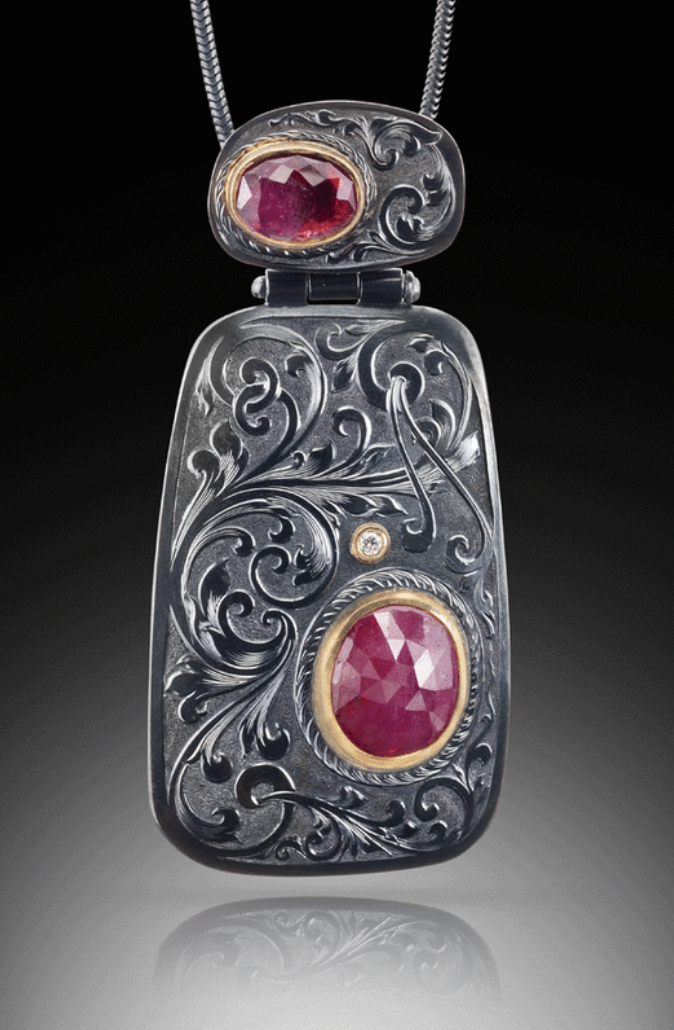 David, Giulietti, Oxidized sterling silver pendant with engraved European gun scroll. Rose cut pink sapphire (lower) and rose cut pink tourmaline (upper) in 18ky settings and accent diamond.