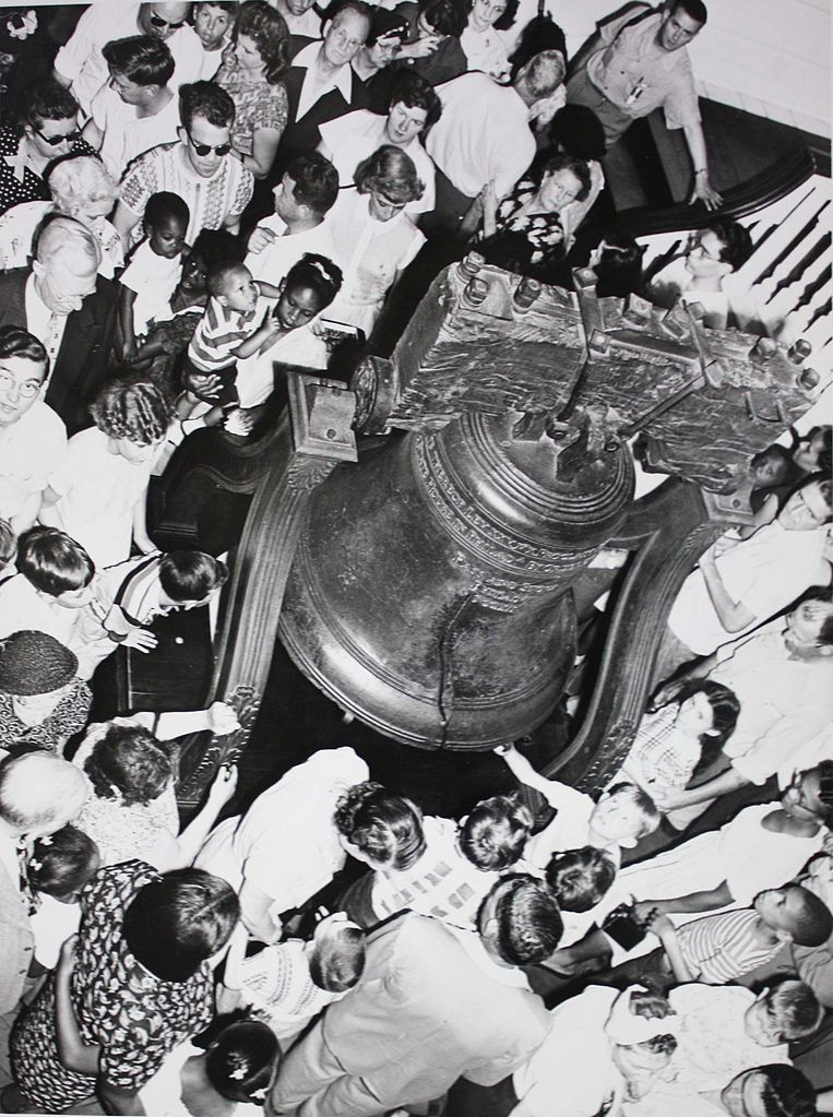 A crowd gathers around the Liberty Bell in Independence Hall, July 3, 1951. Photo:Abbie Rowe, photographer for the National Park Service Independence National Historic Park Library and Archive, Philadelphia PA.Digitization by  Wehwalt