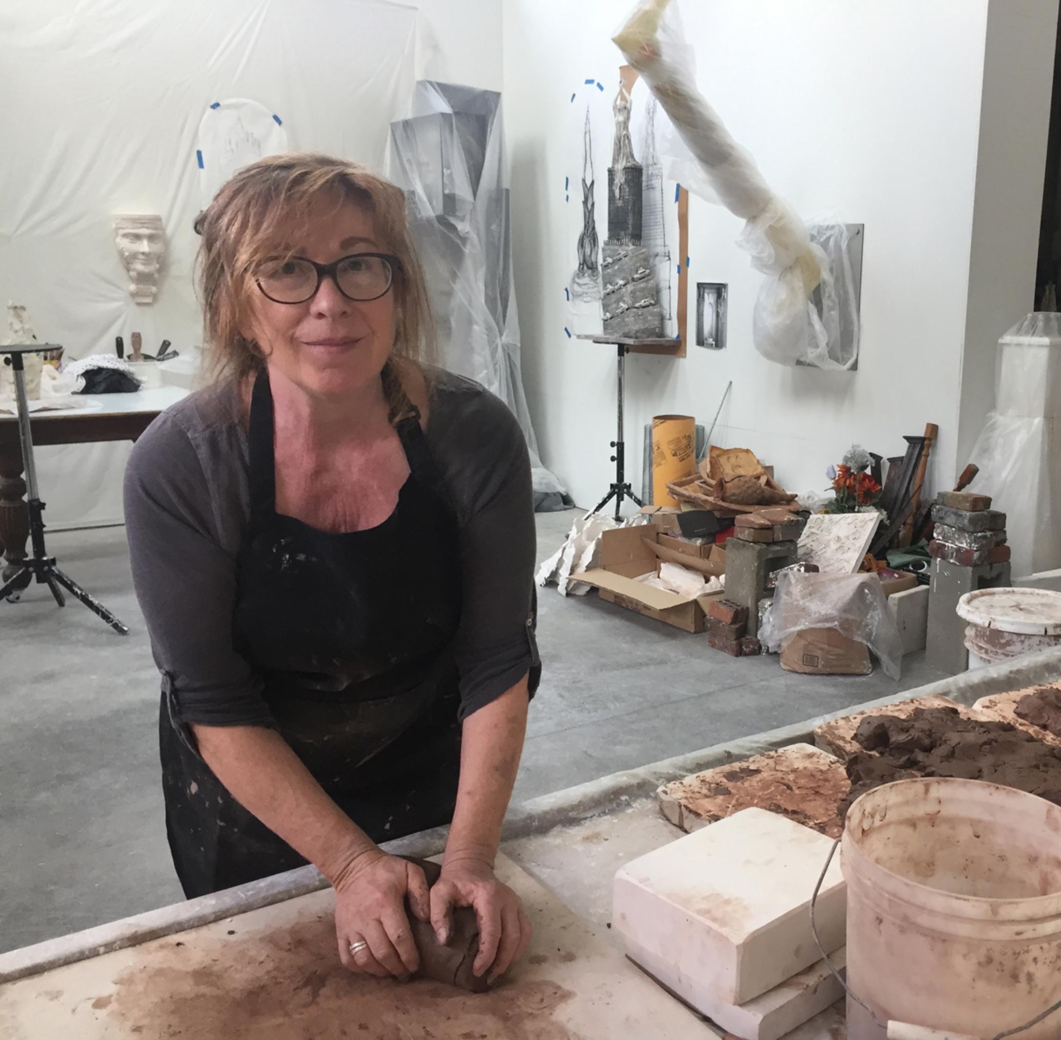 Leslie Fry in her studio preparing clay for the hotel project. Courtesy of the artist.