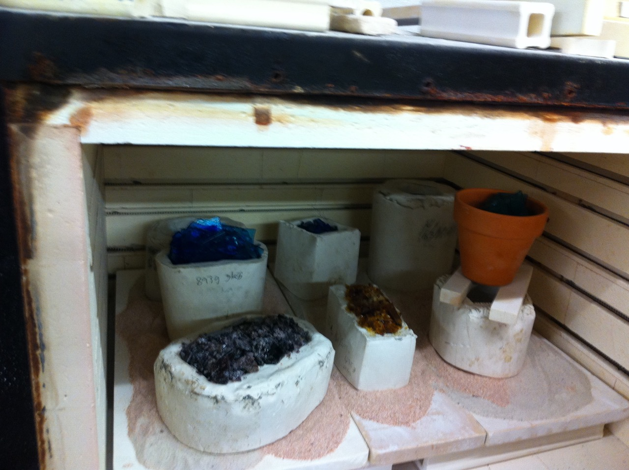 A kiln full of student casting projects