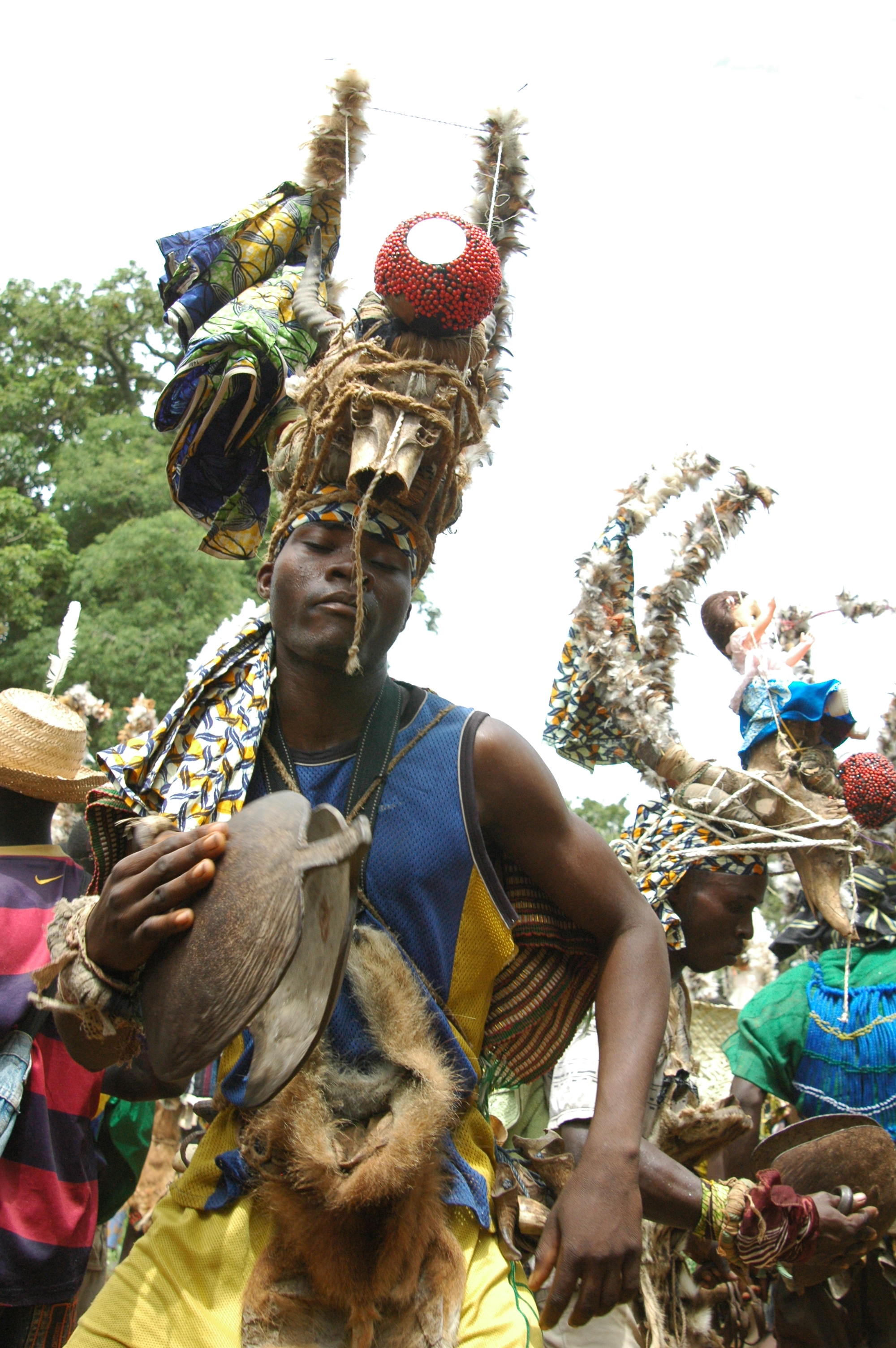 Male initiate performing with the bell as the ceremony commences. Kwede, Togo. © Tom Joyce, 2010