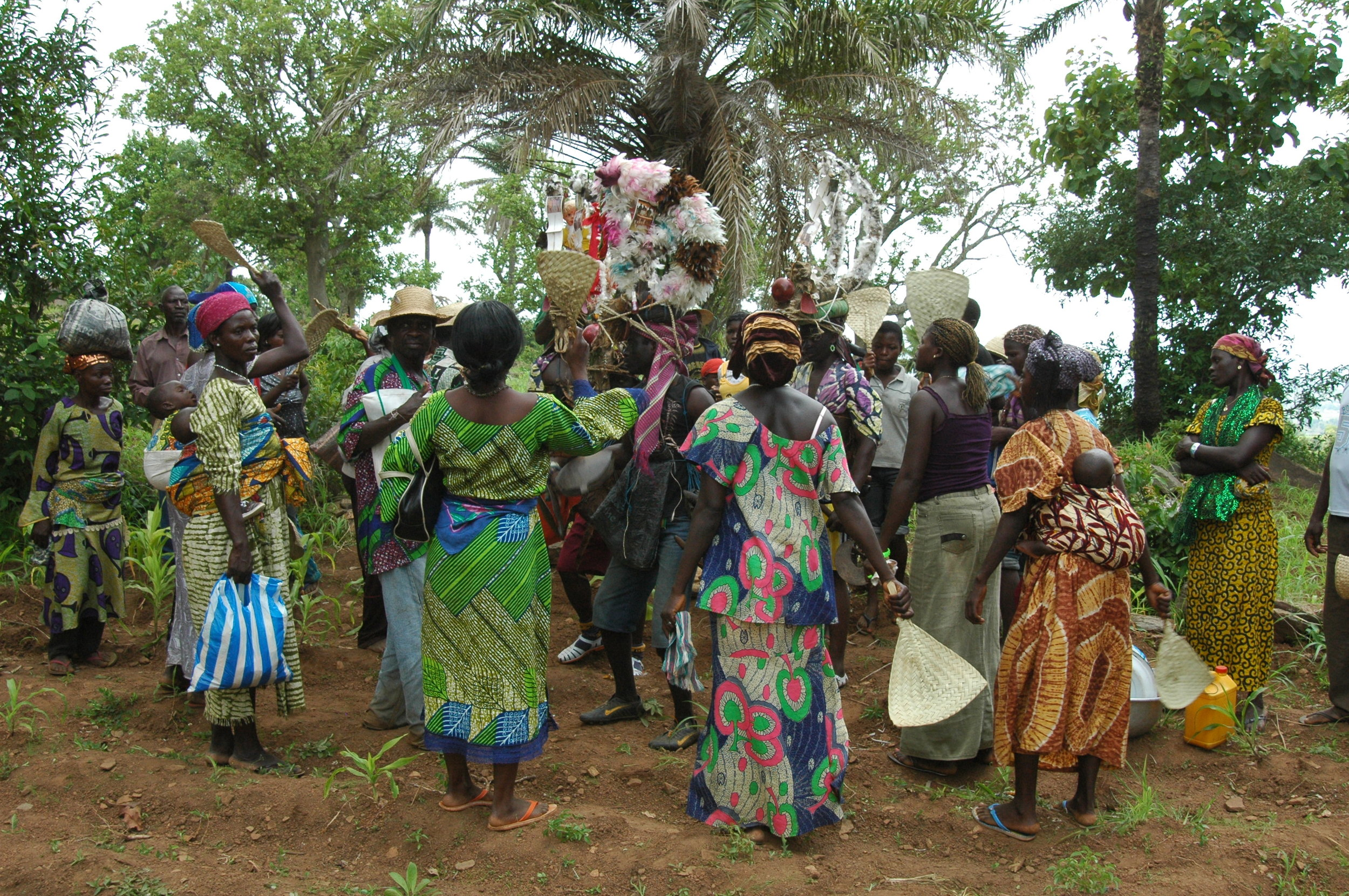 Male initiates fanned by family members to keep cool as the ceremony progresses. Kwede, Togo. © Tom Joyce, 2010