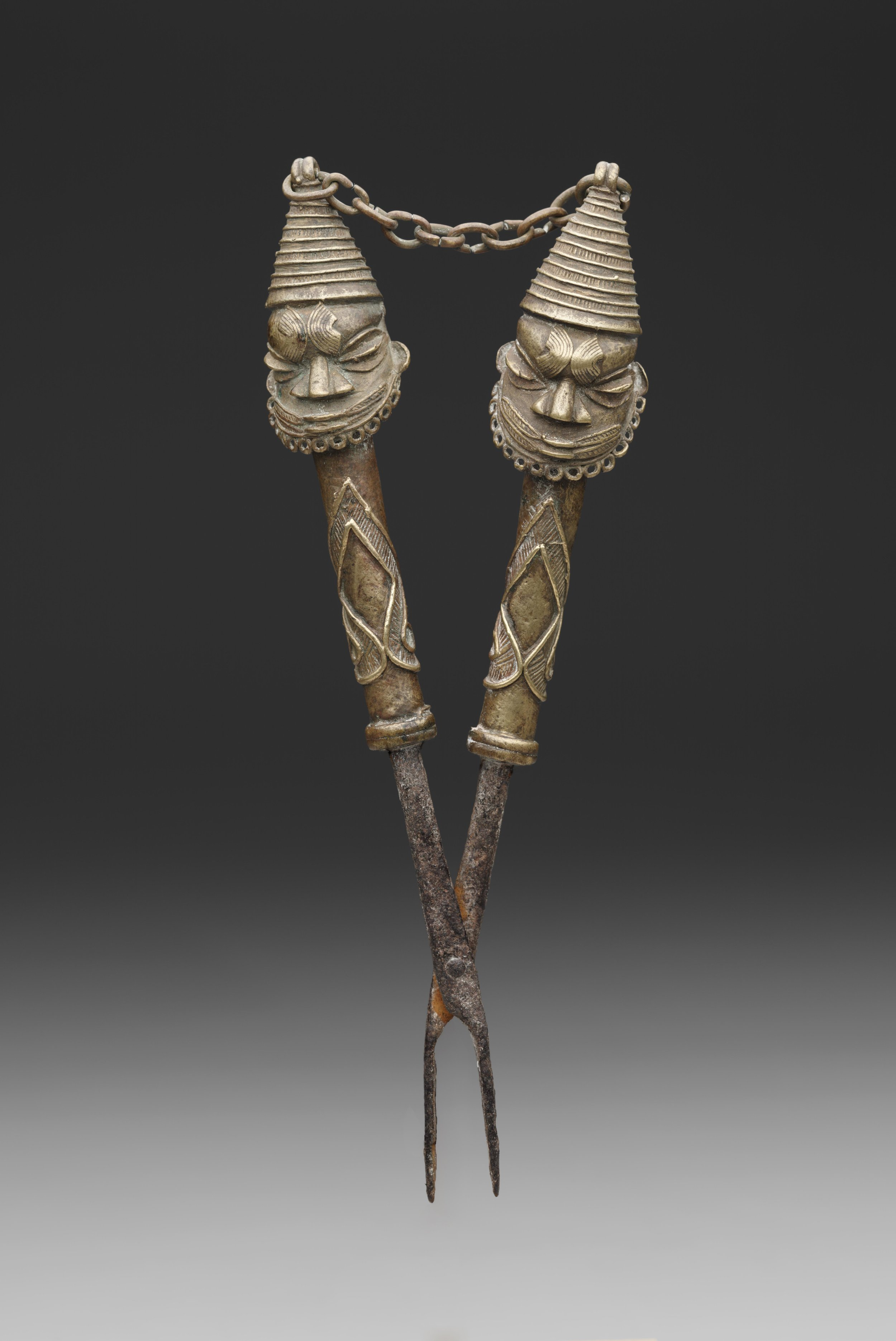 Artist unknown (Yorùbápeoples, Nigeria), figurated tongs for ÒṣùgbóSociety, early to mid-20th century, iron, copper alloy (cast).Dallas Museum of Art, 2005.92, Gift of George and Sidney Perutz in honor of Roslyn A. Walker