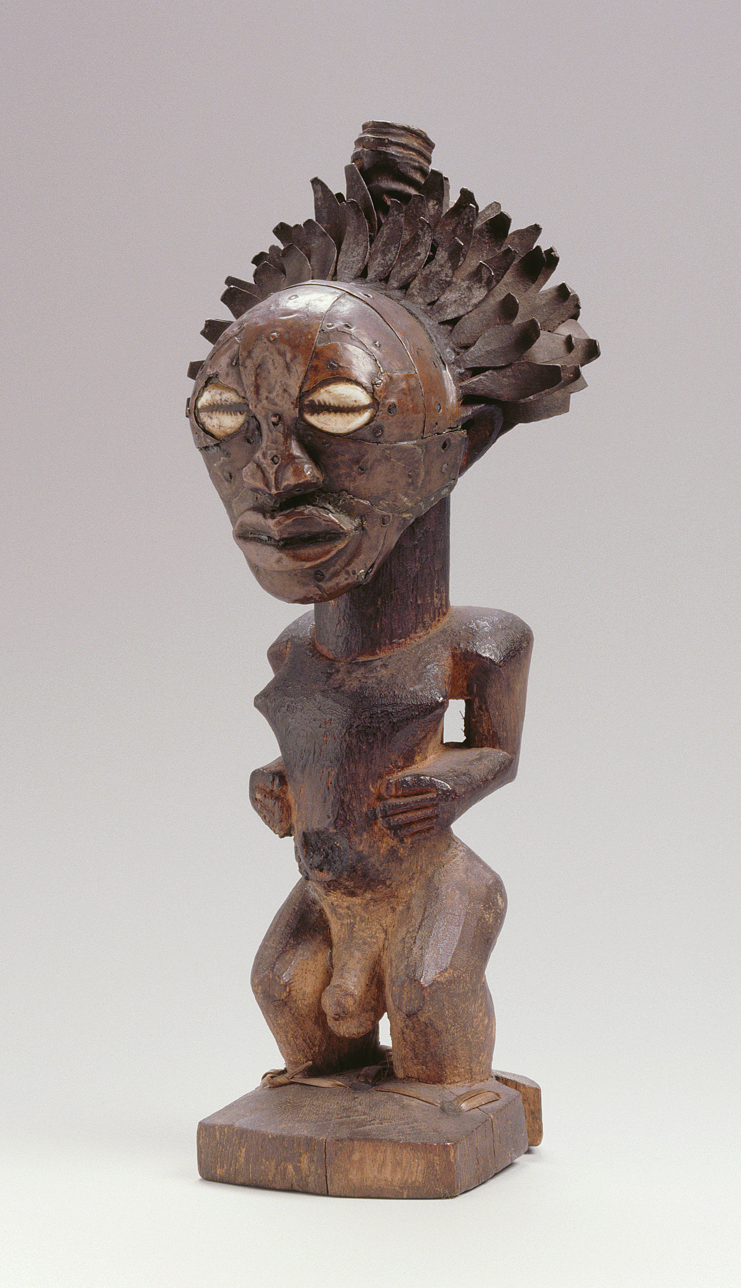 """Artist Unknown (Songye peoples, Democratic Republic of the Congo),Nkishi figure, mid to late 19th century, wood, forged iron, copper alloy, cowrie shell, horn,H: 28.5 cm, W: 12 cm.Collection of the MAS, Antwerp, Belgium (AE.0720), Gift of Louis Franck,Antwerp, 1920.Image © MAS 
