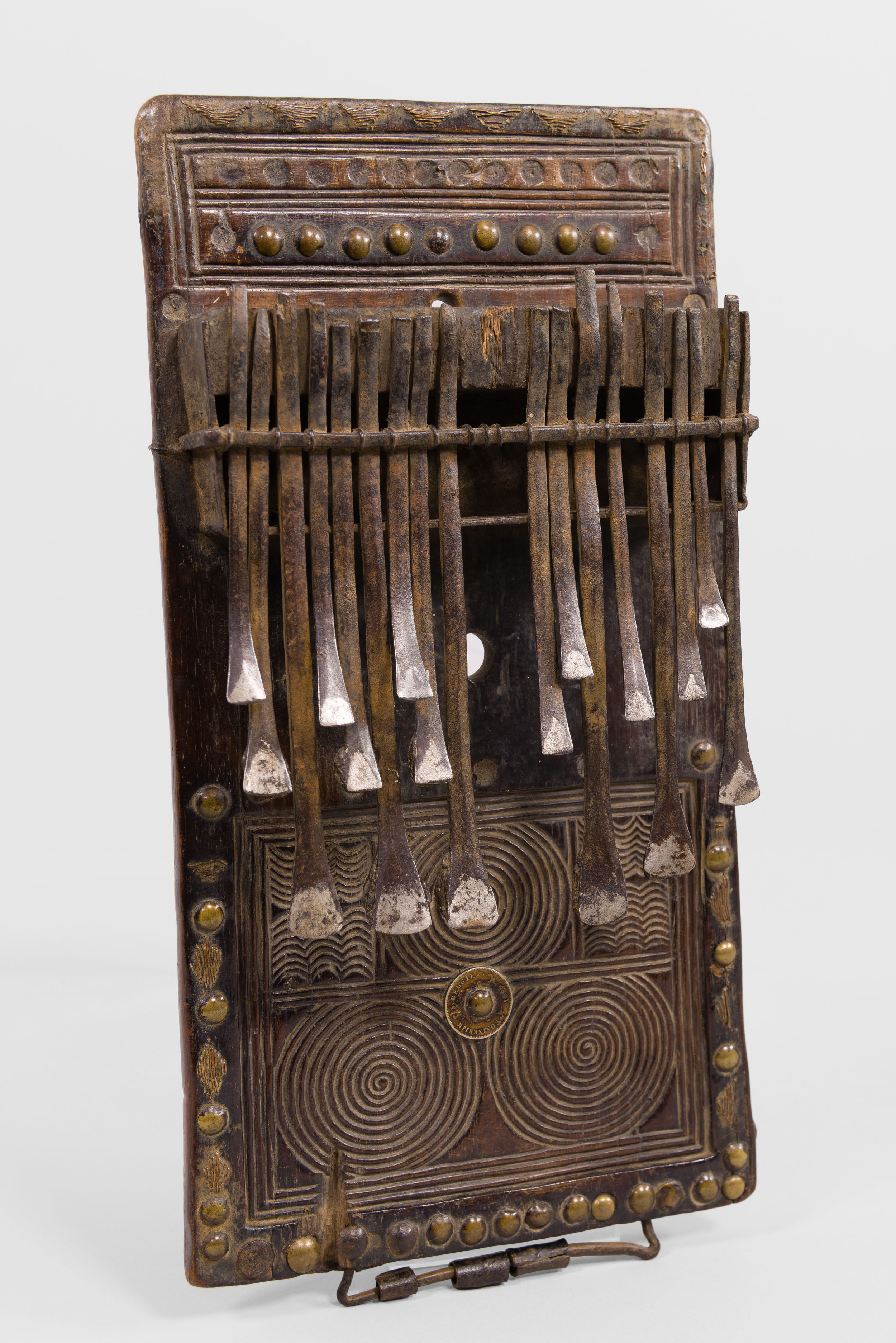 Artist unknown (Chokwe peoples, Angola), lamellophone (chisanji), late 19th century, wood, iron,H: 36.2 cm, W: 18.7 cm, D: 5.1 cm.Musical Instrument Museum 2013.56.1.Image © Musical Instrument Museum. Photograph Troy Sharp, 2016