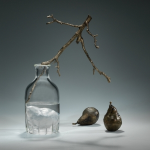 Joanna Manousis,  Bottled Pear , 2017. Negative-core cast / blown / hand-polished glass, lost-wax cast bronze, patina, dimensions variable. Photo: Tom Brookes. Courtesy of Todd Merrill Gallery, NY, NY.
