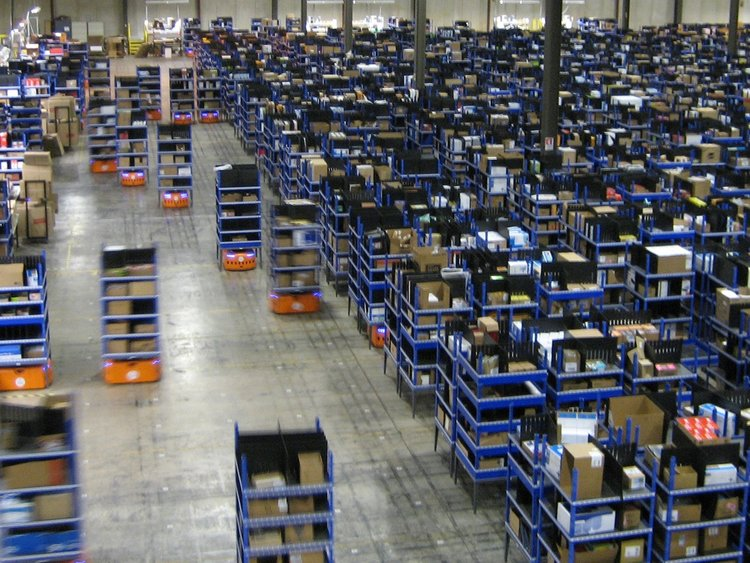 Amazon robots move inventory for pick, pack, and shipment.