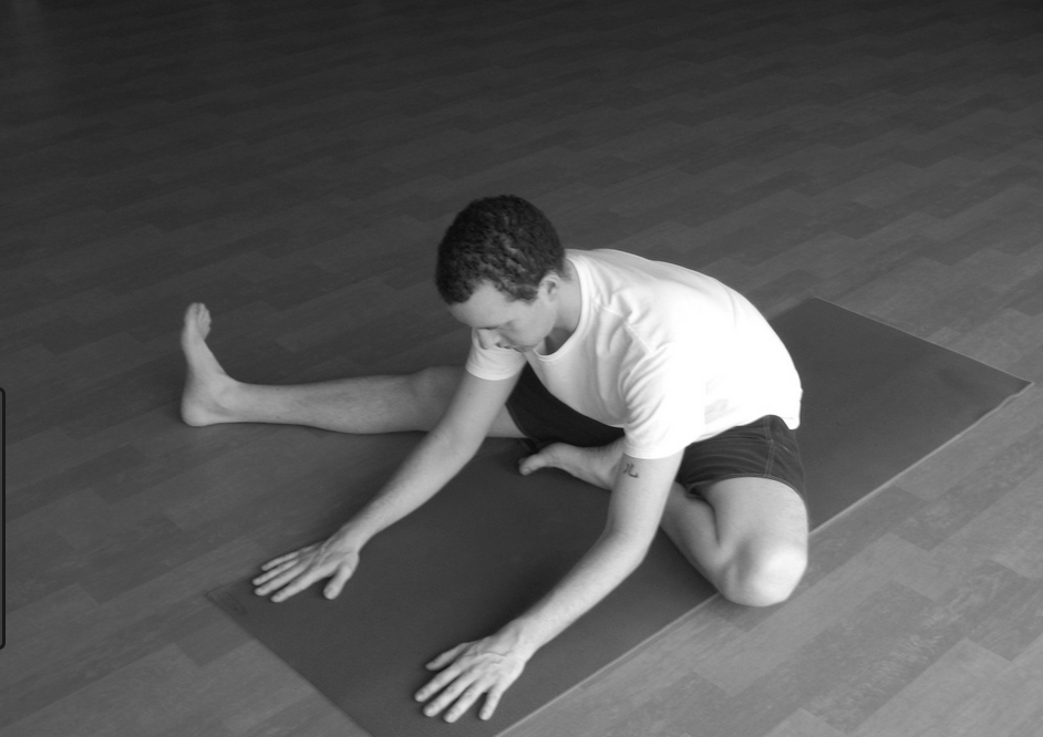 1. Sit with legs outstretched.2. Bend the right leg and place the right foot as far up on the left thigh as possible.  3. Place the right hand on top of the bent right knee.Hold the toes of the right foot with the left hand.  4. While breathing in, gently move the right knee up towards the chest.  5. Breathing out, gently push the knee down and try to touch the floor.  6. The trunk should not move.  7. Movement of leg should be achieved by the exertion of the right arm.  8. Repeat with left leg. Slowly practice about 10 up and down movements with each leg or hold in a relaxed position for 3-5 minutes. Do not strain.