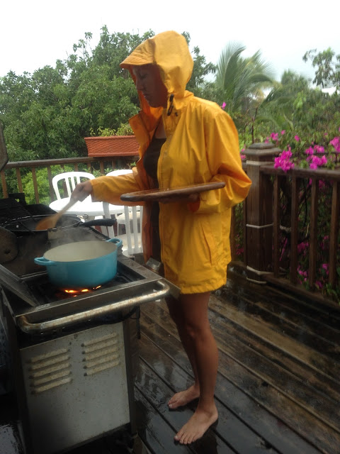 Cooking in pouring rain & lightening storm. Happy camper? Not so much...