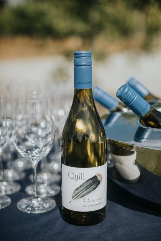 Blue Grouse offers indoor and outdoor settings for a ceremony and reception. Here, Blue Grouse Estate Winery's Quill White awaits wedding guests. Sweet Heirloom Photography.