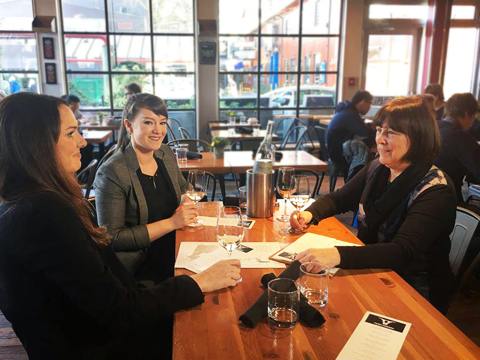 Christine Coletta, organizer of Farm Friends and owner of Okanagan Crush Pad winery, with Lauren Skinner from Painted Rock Winery and Harriet Whitecross from Edible Canada, enjoying local BC wine while discussing details of Farm Friends event.