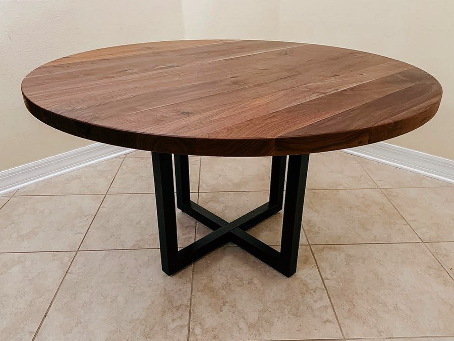 round walnut dining table with steel legs
