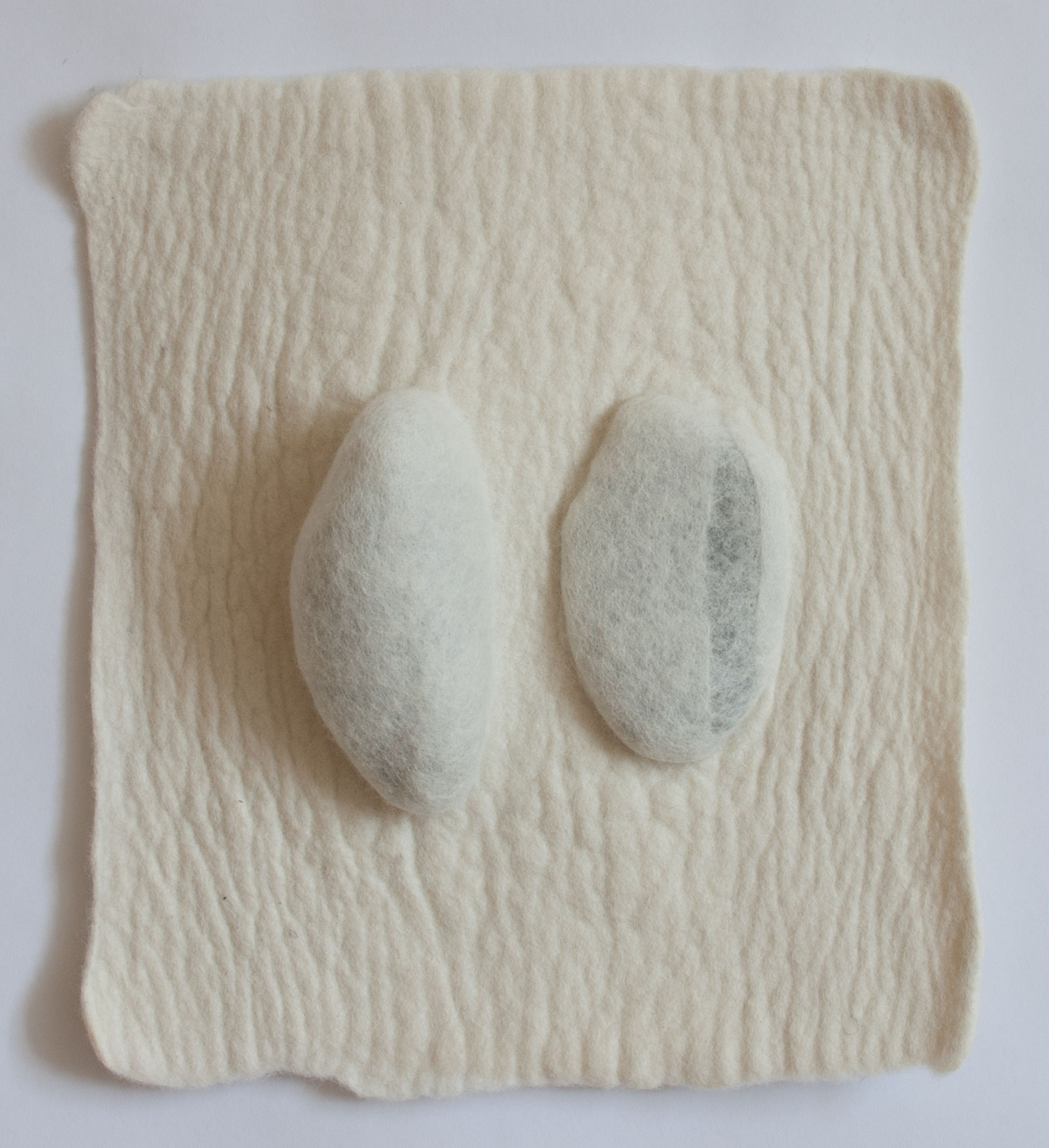 Untitled  Handfelted merino wool, rocks  2017