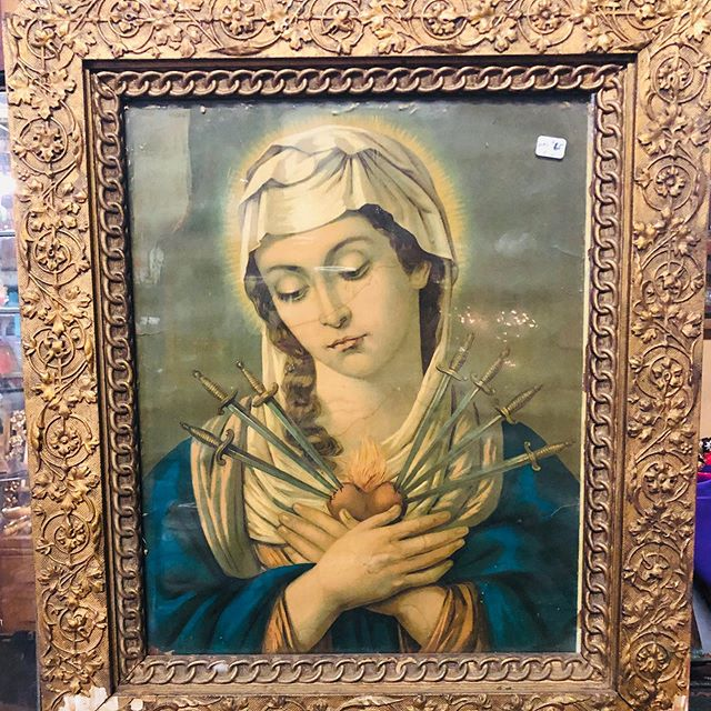 Our Lady of Sorrows in ornate antique frame.  Wonderful image of Mary with seven blades piercing her heart. #ourladyofsorrows #marianart #mothermary #catholiciconography #alleycatvintagemercantile