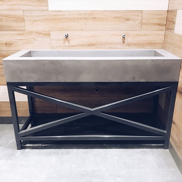 Our concrete ramp sink sitting on this industrial steel frame is a perfect match for this Brisbane commercial space 🐐 colour, Rove #concrete #concretevanity #concretedesign #concretebathroom #rampsink #industrialdesign #steelframe #industrial #polishedconcrete #concretecountertops #brisbane