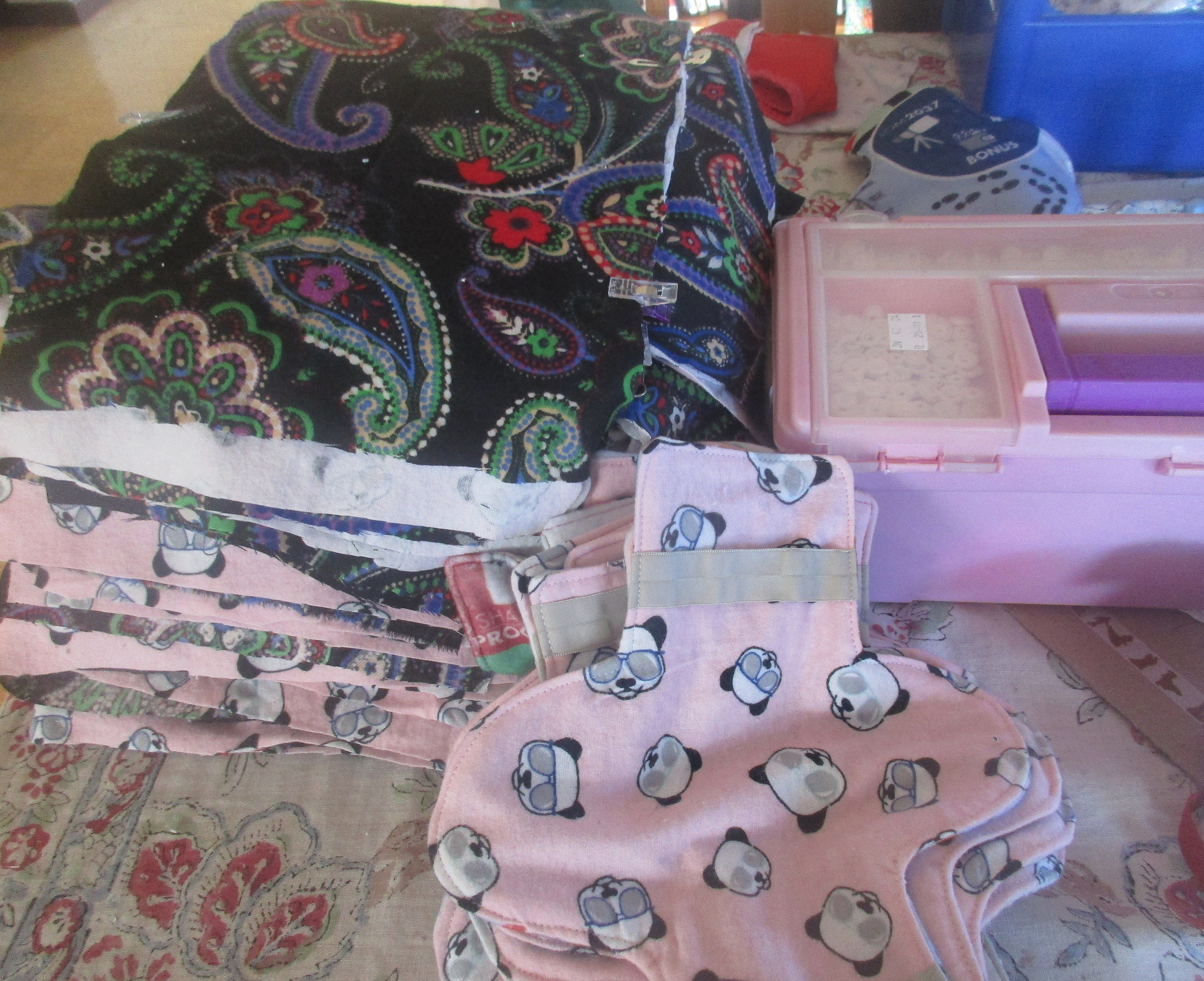 Recycling fabric into reusable maternity pads. *All pics taken and posted with permission*