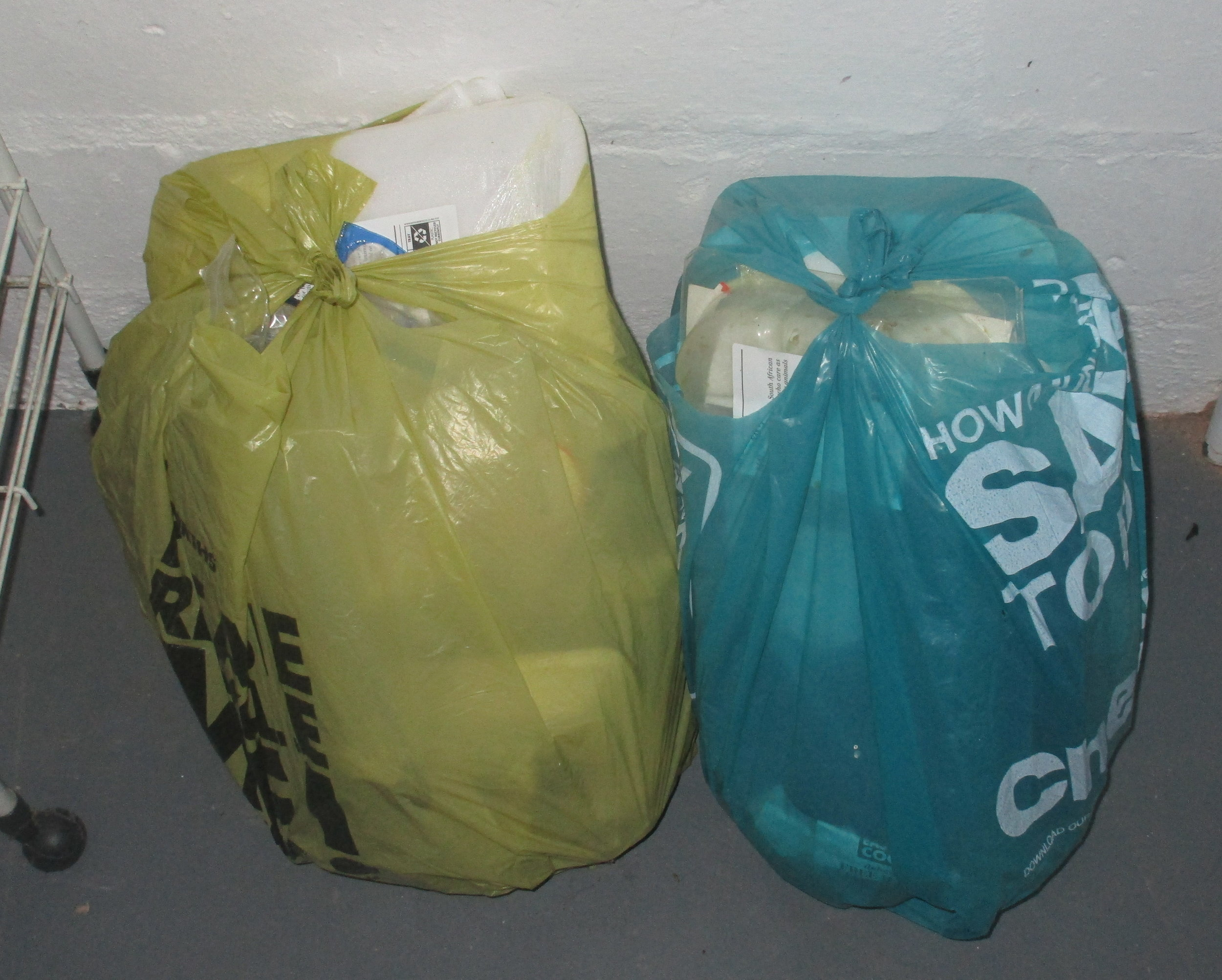 In five months, two bags of unrecyclable waste (irony: spot the recycling sign on the polystyrene tray that held raw meat…)