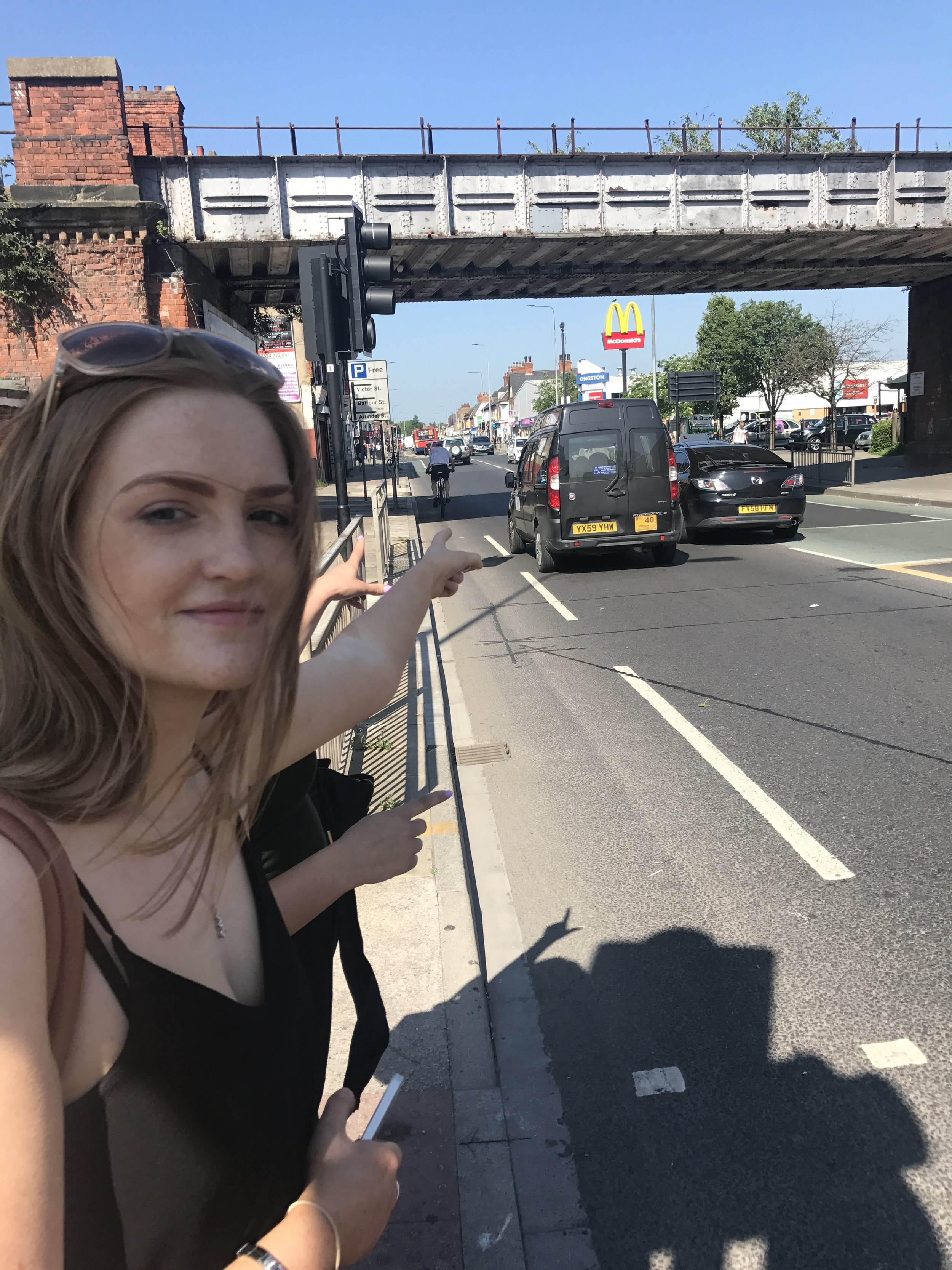 Melissa pointing at our broken taxi