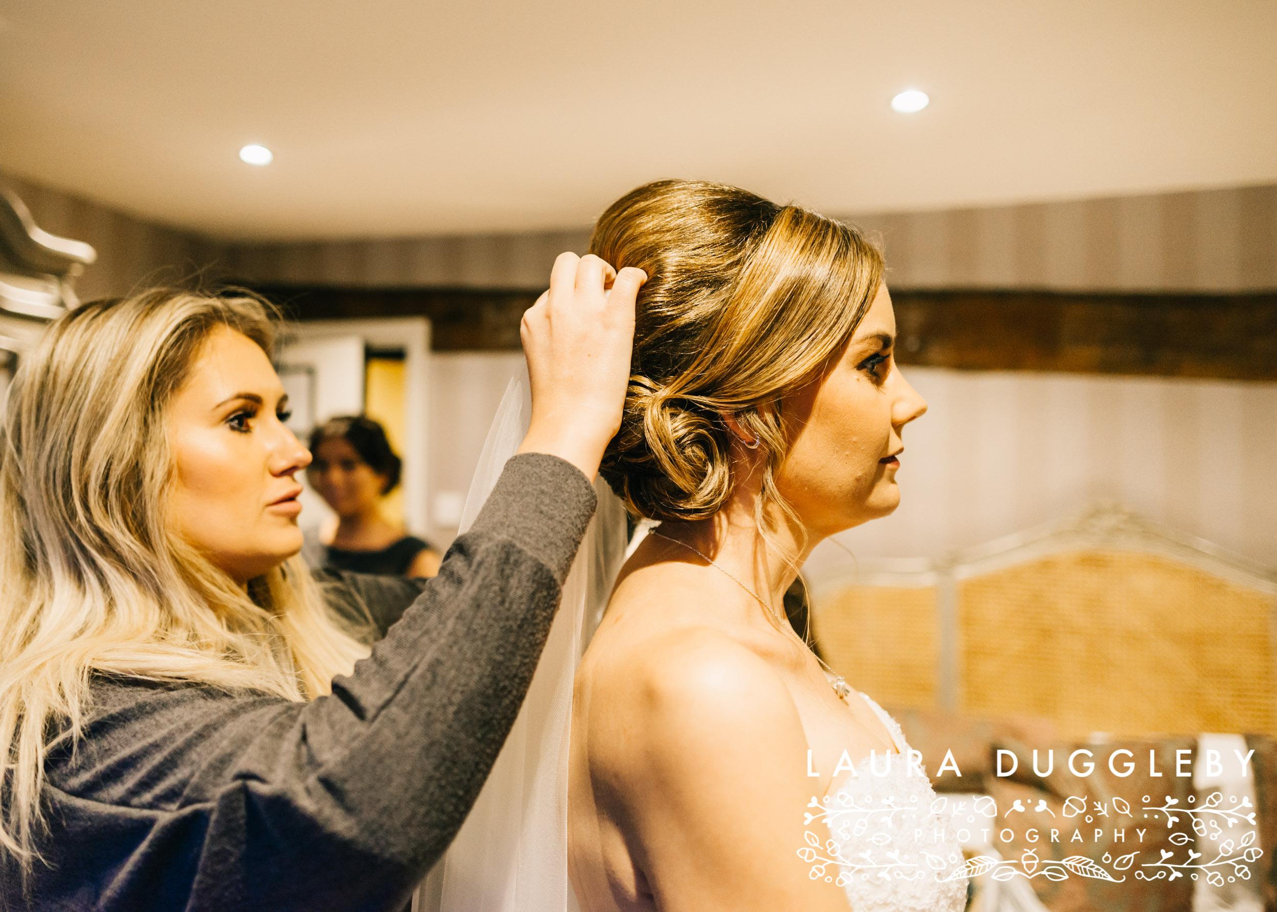 Ribble Valley Wedding Bride Having Veil Put In Hair Shireburn Arms
