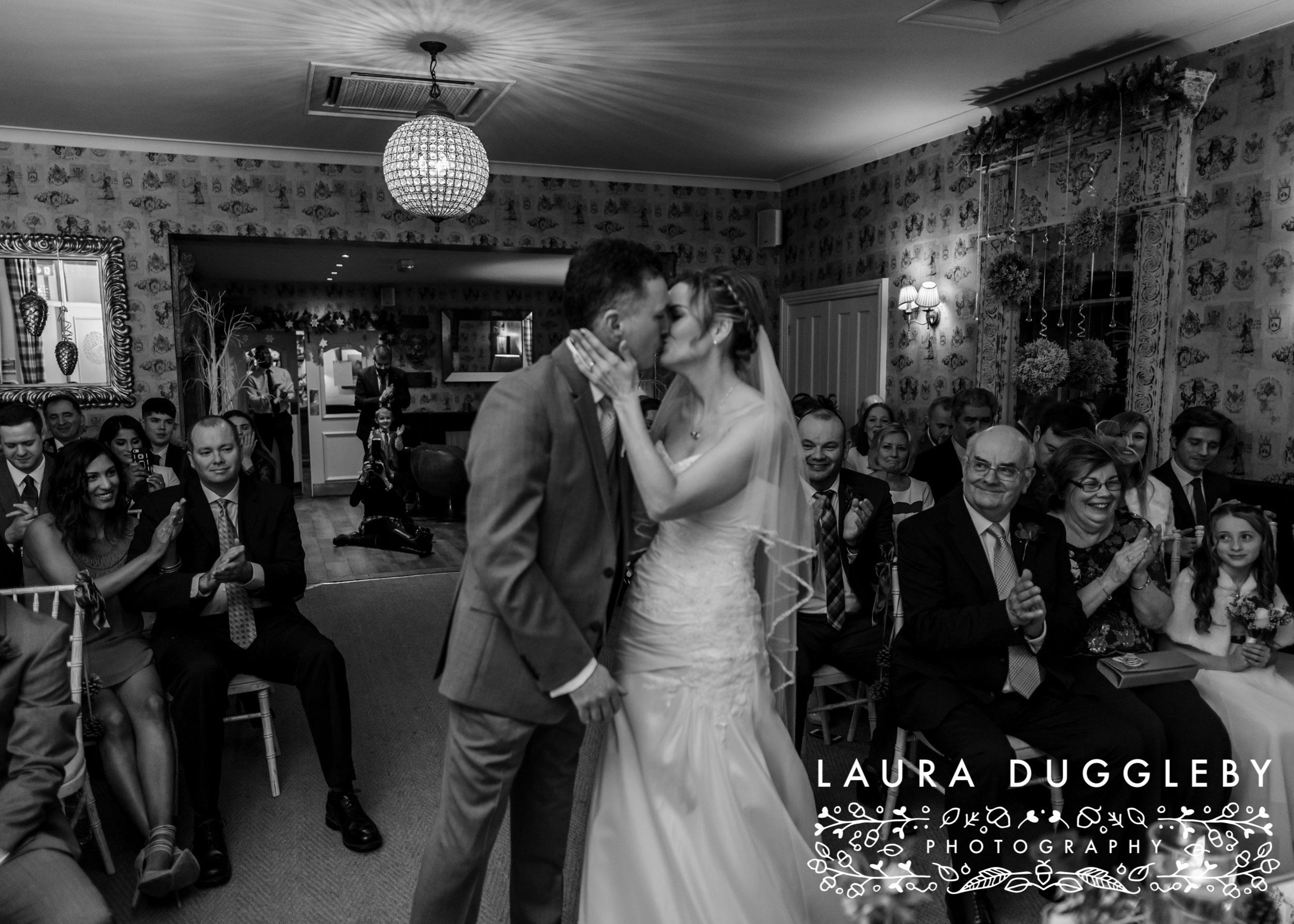 Shireburn Arms Wedding Bride and Groom Kissing