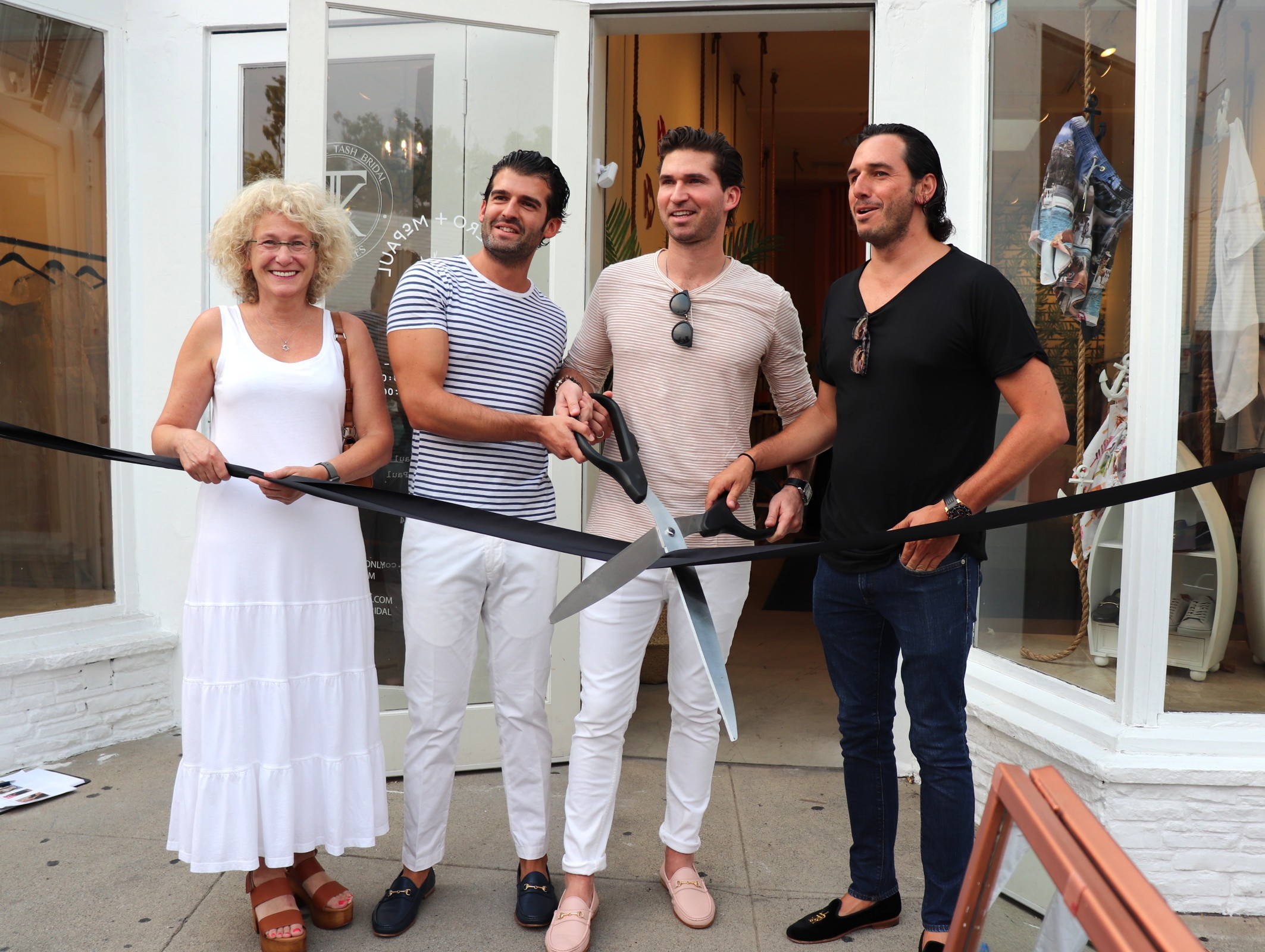 West Hollywood Councilmember Lauren Meister, Co-founder Rual Gonzalez, Co-founder Hernan Junco, and business partner Patricio Jourdain at the ribbon-cutting ceremony of Romero+McPaul
