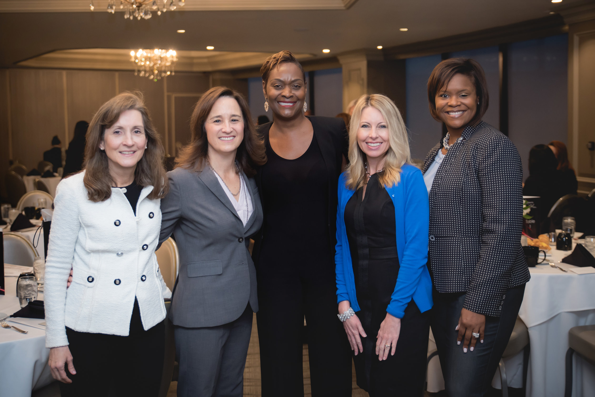 "Dr. Tammy Wong, CEO of Fostering Executive Leadership in Irvine, Lisa Haines, Vice President of Communications and Public Affairs for Disneyland Resort in Anaheim, Leadership in Heels Founder and CEO Scharrell Jackson, Lori Seal, CEO of Blytheco in Laguna Hills, and Lanän Clark, Vice President and Associate Market Manager of Merrill Lynch in Newport Beach, pose for a photo at Leadership in Heels ""Journey to the Top: The Juggling Act"" on Thursday, March 21, 2019 at the Center Club in Costa Mesa. They were featured on the event panel. / Photo by Kait McKay Photography"
