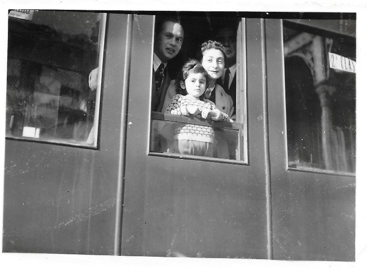"""Leaving Portugal"" January 23, 1942 Caldas da Rainha train station - Ignas, Hala and Yvonne Krakowiak with Senhor Alberto Malafaia in the shadow. Photographer unknown."