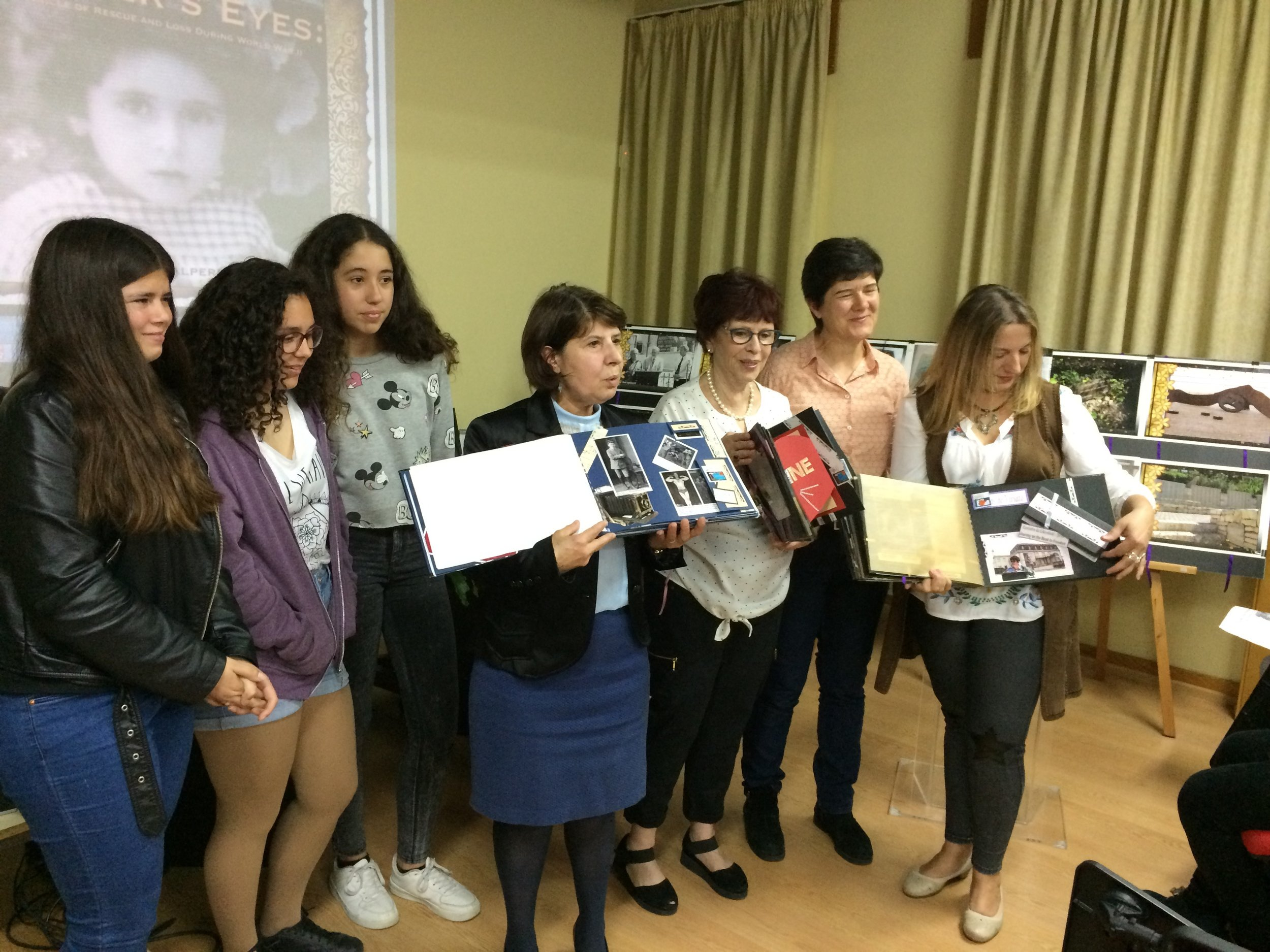 Joan with UNESCO teachers - Dores do Carmo, Lurdes Cruz and Josefa Reis - and student presenters.