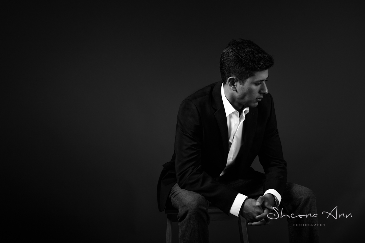 Attractive man sitting thinking