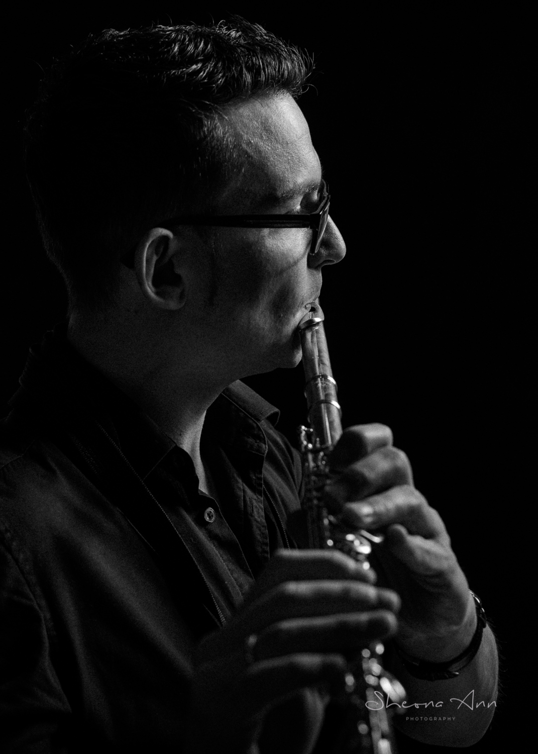 moody portrait of musician plying the flute