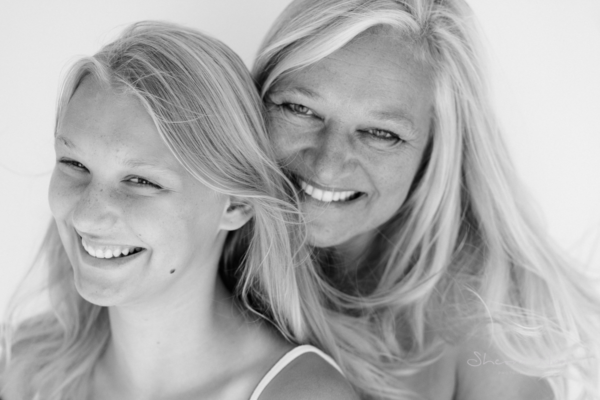 summertime portrait mother and daughter laughing