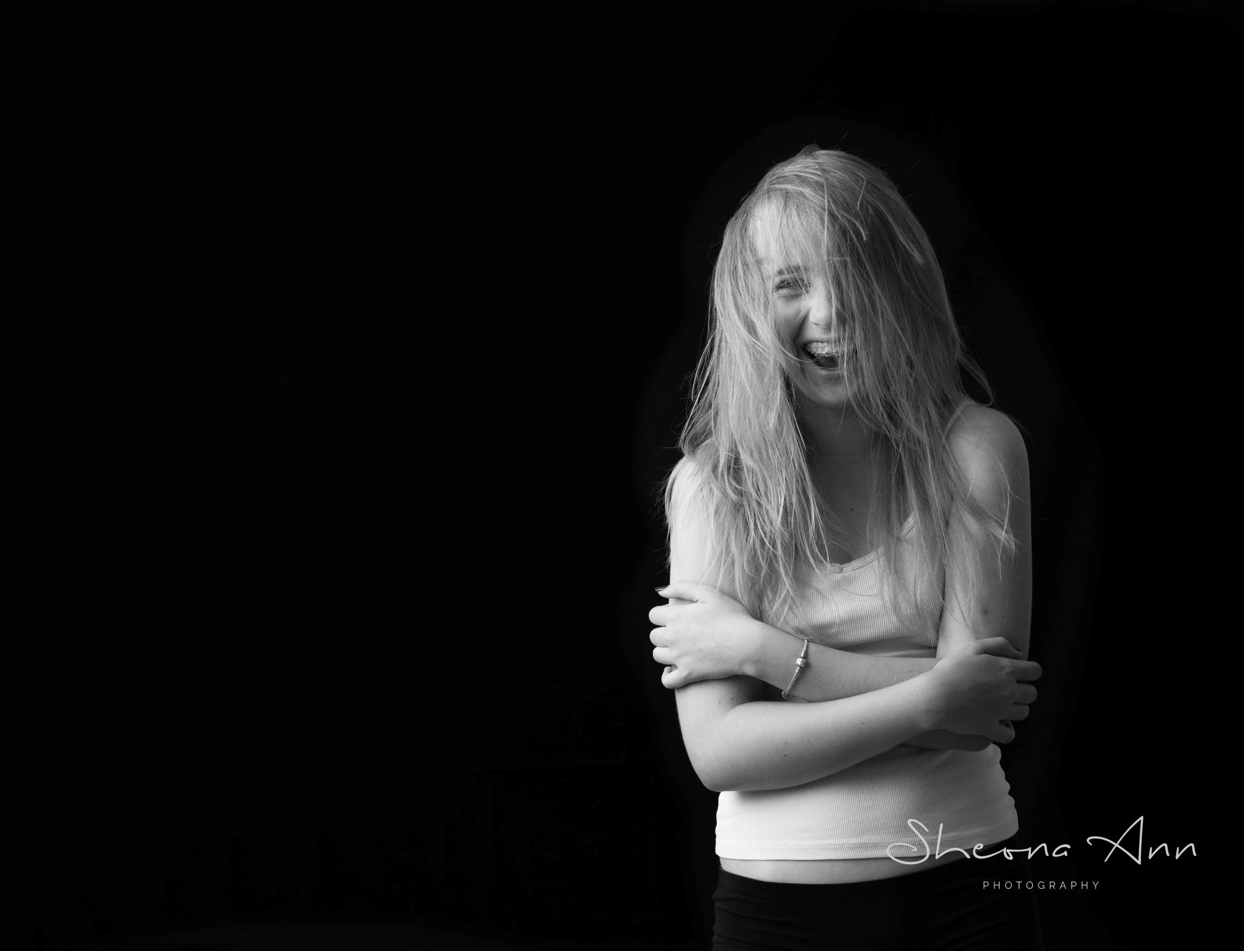 teenager laughing with crazy hair