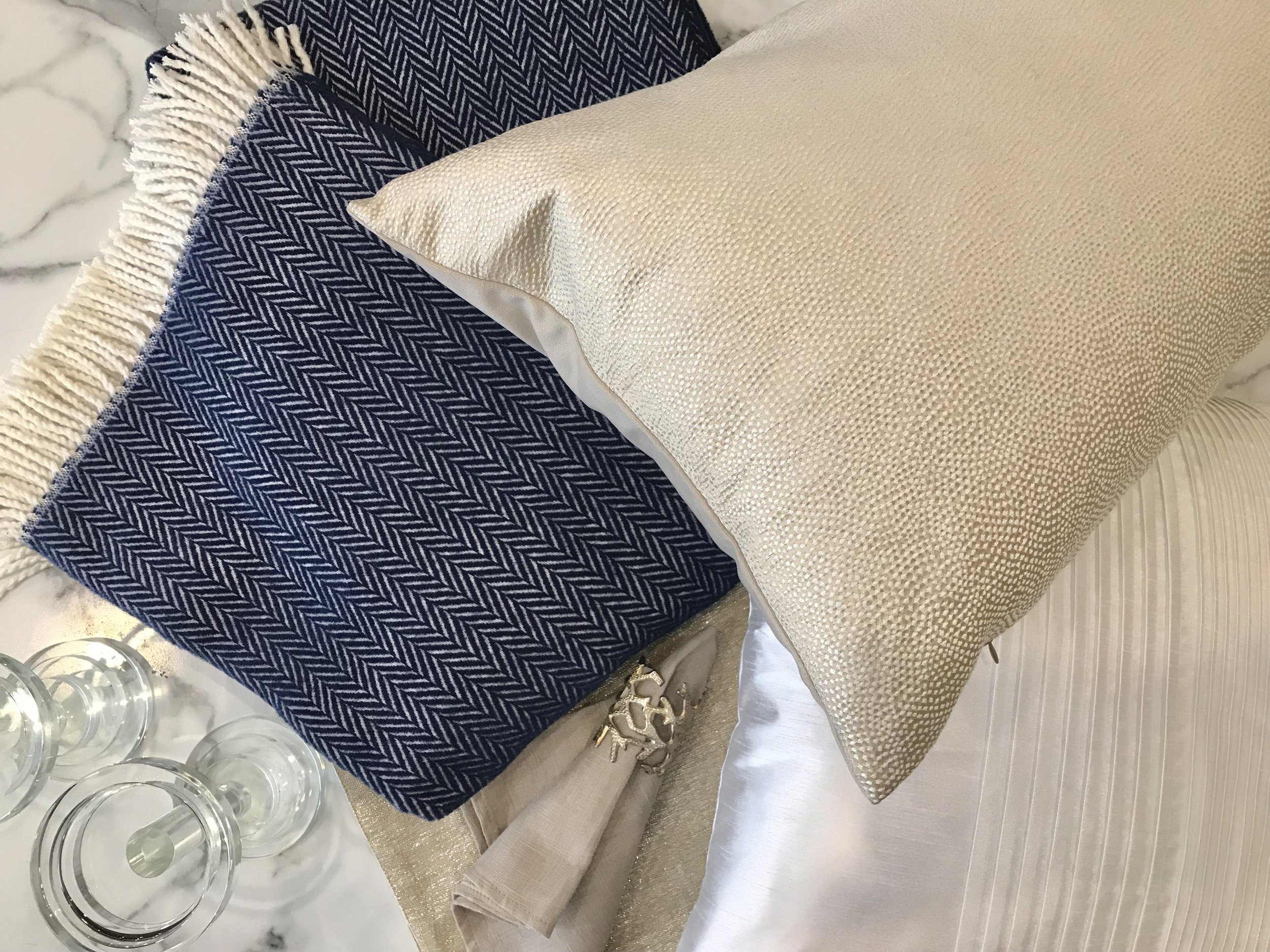 Crystal Candle Pillar (small) - $56.95 (medium) - $63.95, Blue Chevron Throw - $98.95, Gold Placemat - $23.95, Linen Napkin - $43.95, Silver Coral Napkin Ring - $14.95, Champagne Lumbar Pillow - $74.95, White Pleated Pillow - $48.95
