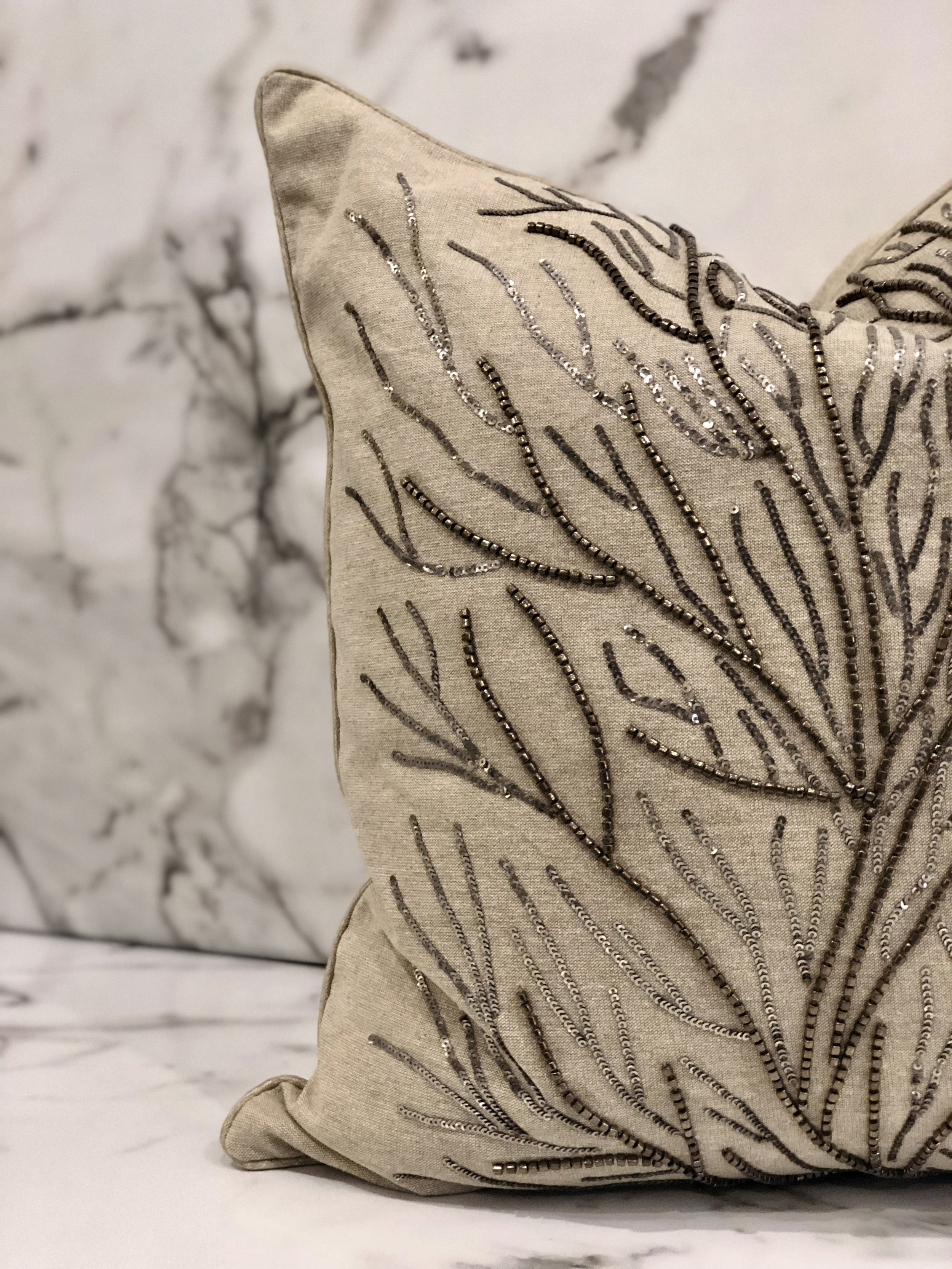 Beading - Beading is a simple way to add beauty and sparkle to any space. The delicate touch needed for a beaded product is proof of the quality and high end materials. Any beaded piece is sure to wow your guests.Pillow - $147.95