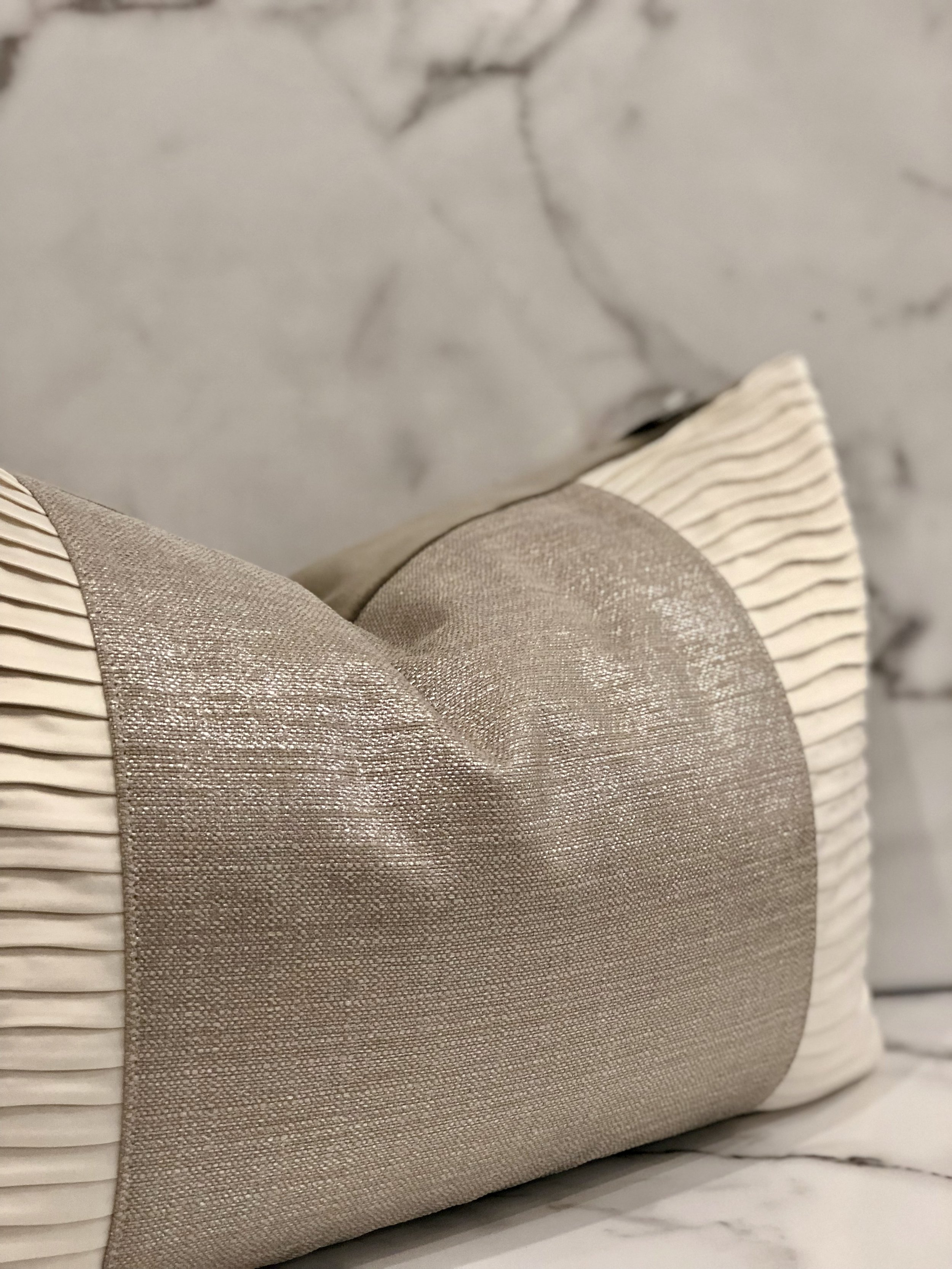 Pleating - A pleat is a style staple and though it is a classic design, many modern products are putting pleats in a modern context. Pleats add interest and style to any fabric.Pillow - $58.95
