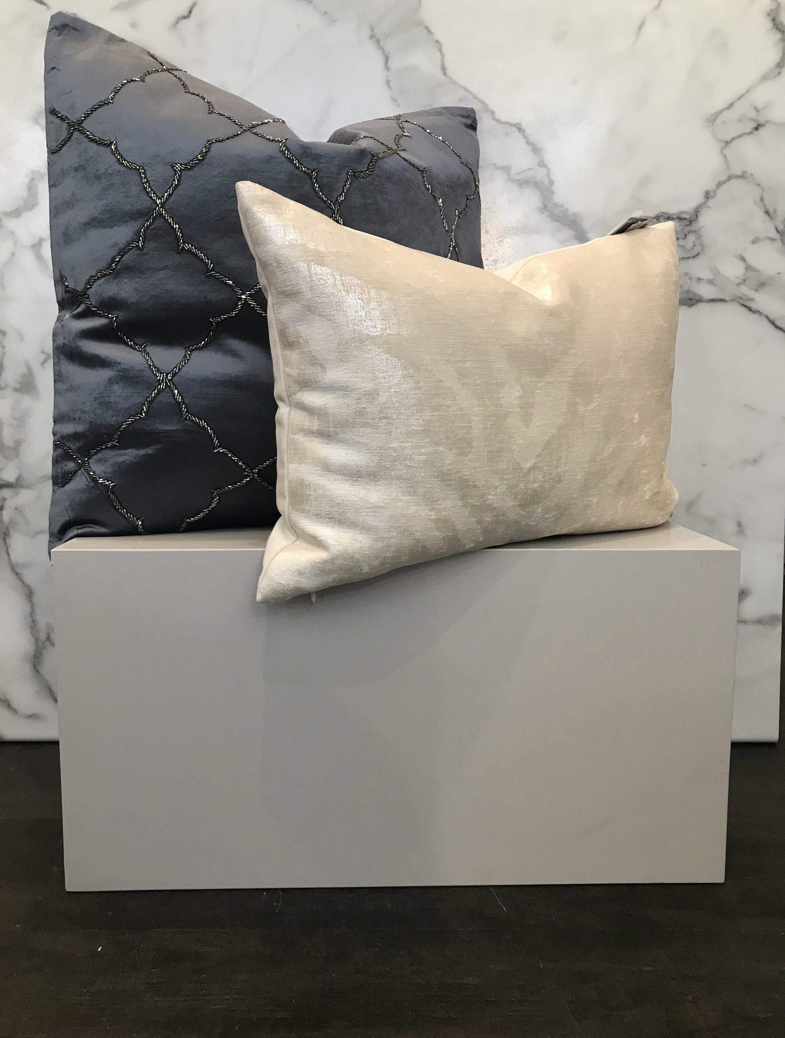 - Every room needs a little shimmer and shine. This beaded quatrefoil pillow is a subtle bit of sparkle, but when light hits the beading it will create a large impact. This metallic printed pillow is the perfect pair.