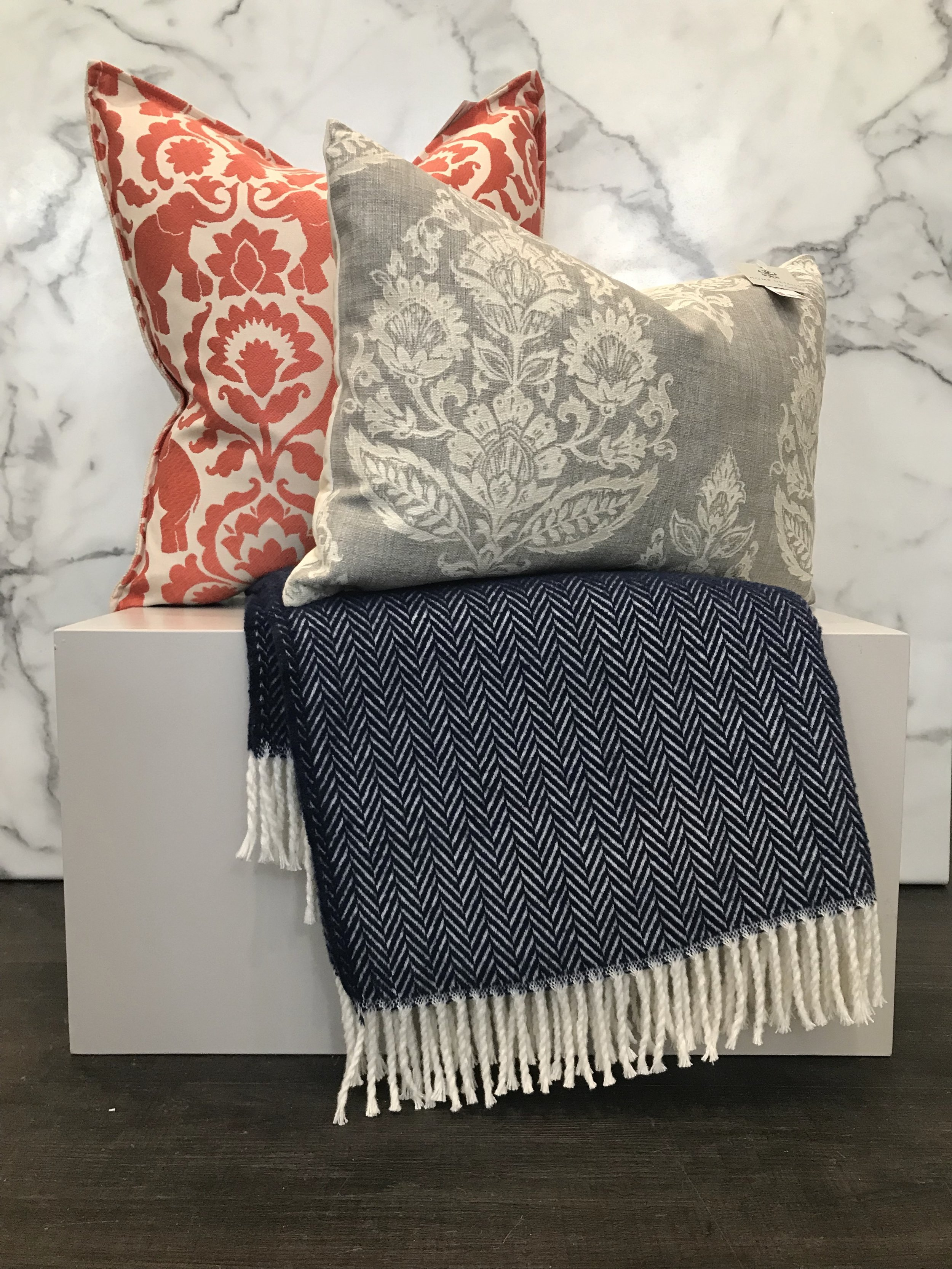- This is definitely the most eclectic of the pairings we came up with. All three pieces have bold prints but they are all working together to create a mixed-match look that is eclectic and fun. Coral/orange and navy pair beautifully but are an uncommon pair which adds a unique touch.