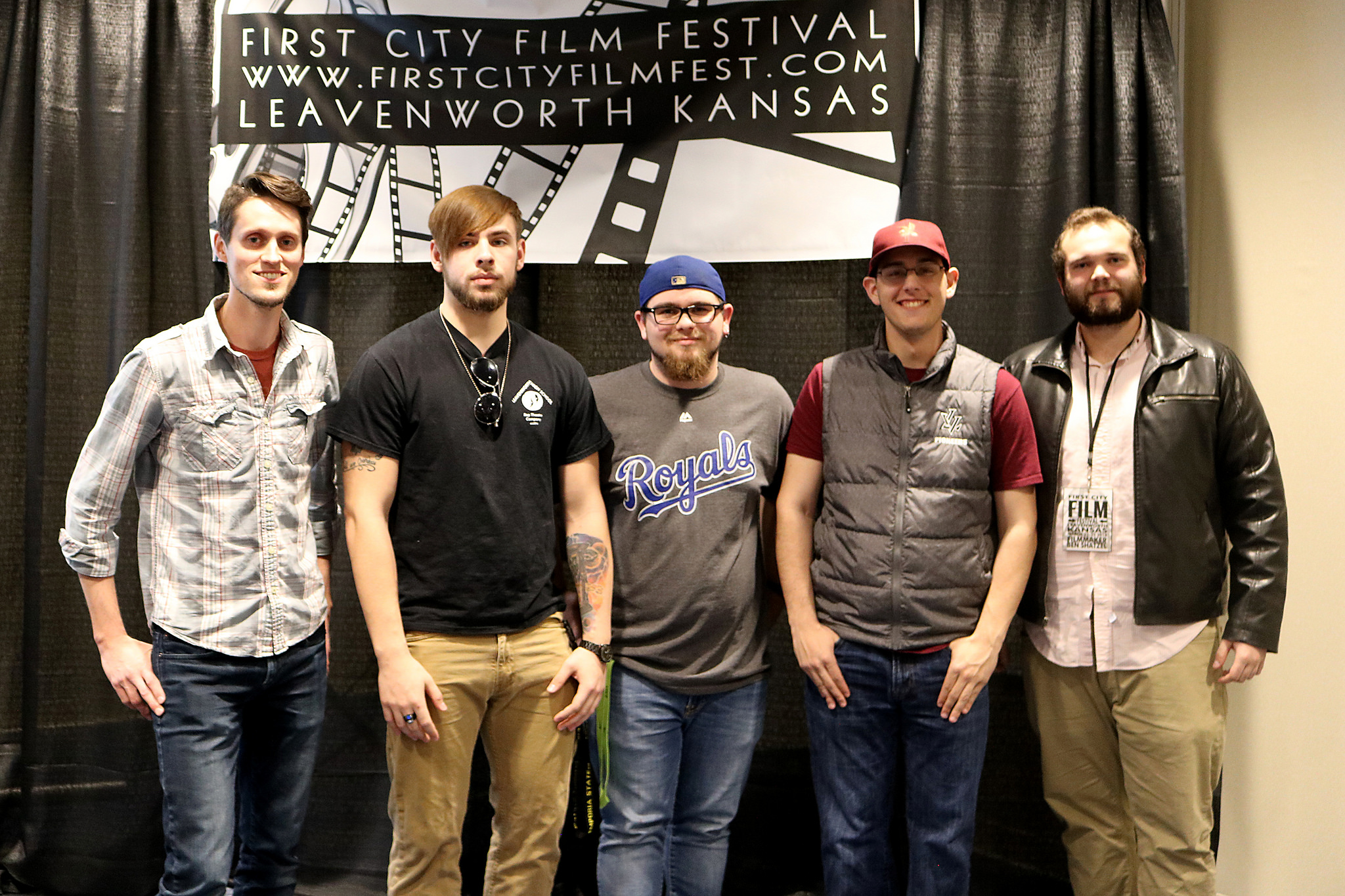 Student filmmakers pose with local filmmaker Caleb Vetter (far left) and Ben Schatzel (far right) after the First City Student Short screenings and awards March 22, 2018. Vetter also served as a judge for the student films.