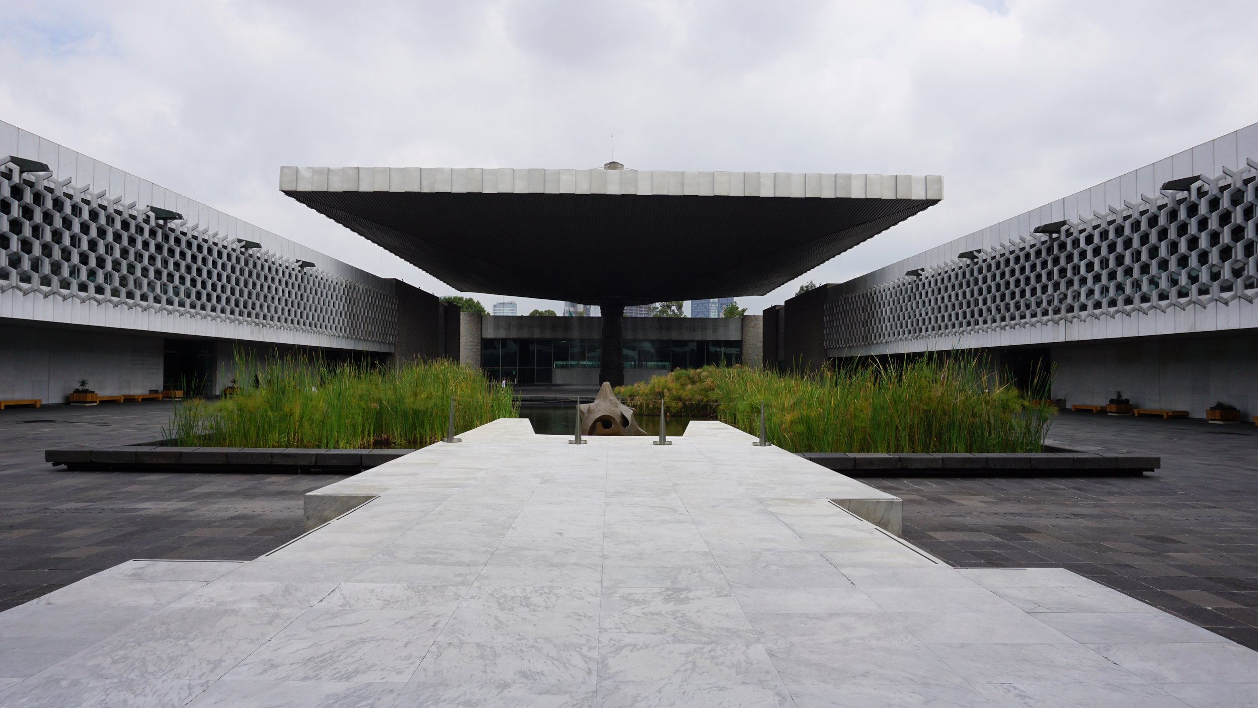 Museo De Antropologia - Pedro Ramirez Vazques' building is a work of art all on it's own. The architecture is simply stunning. I literally sat here, admiring the buildings' lines and details, the people walking in and out for over an hour.